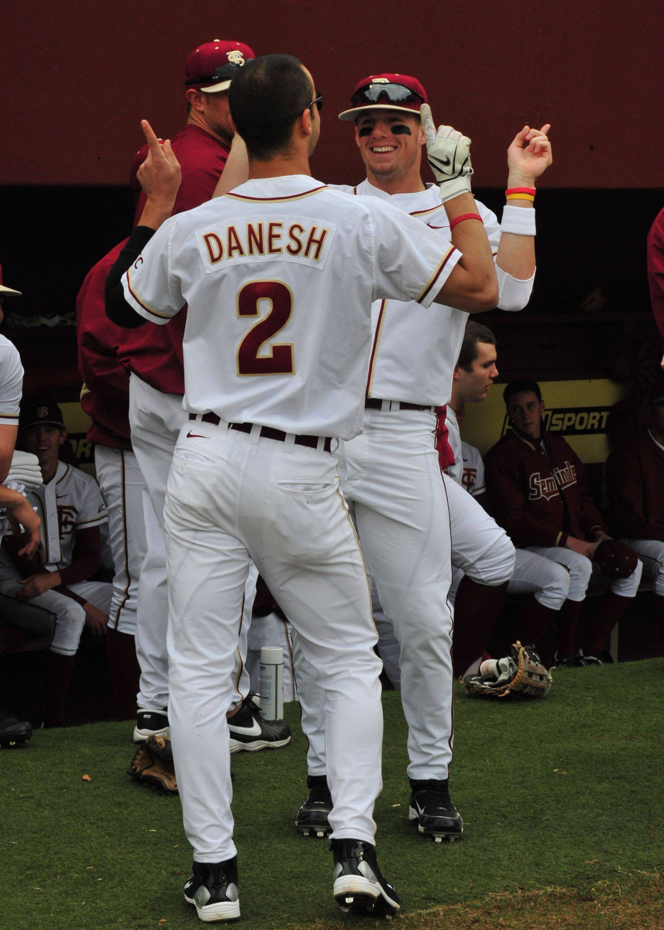 Ohmed Danesh and Tyler Holt show off their dance skills before the start of the game.