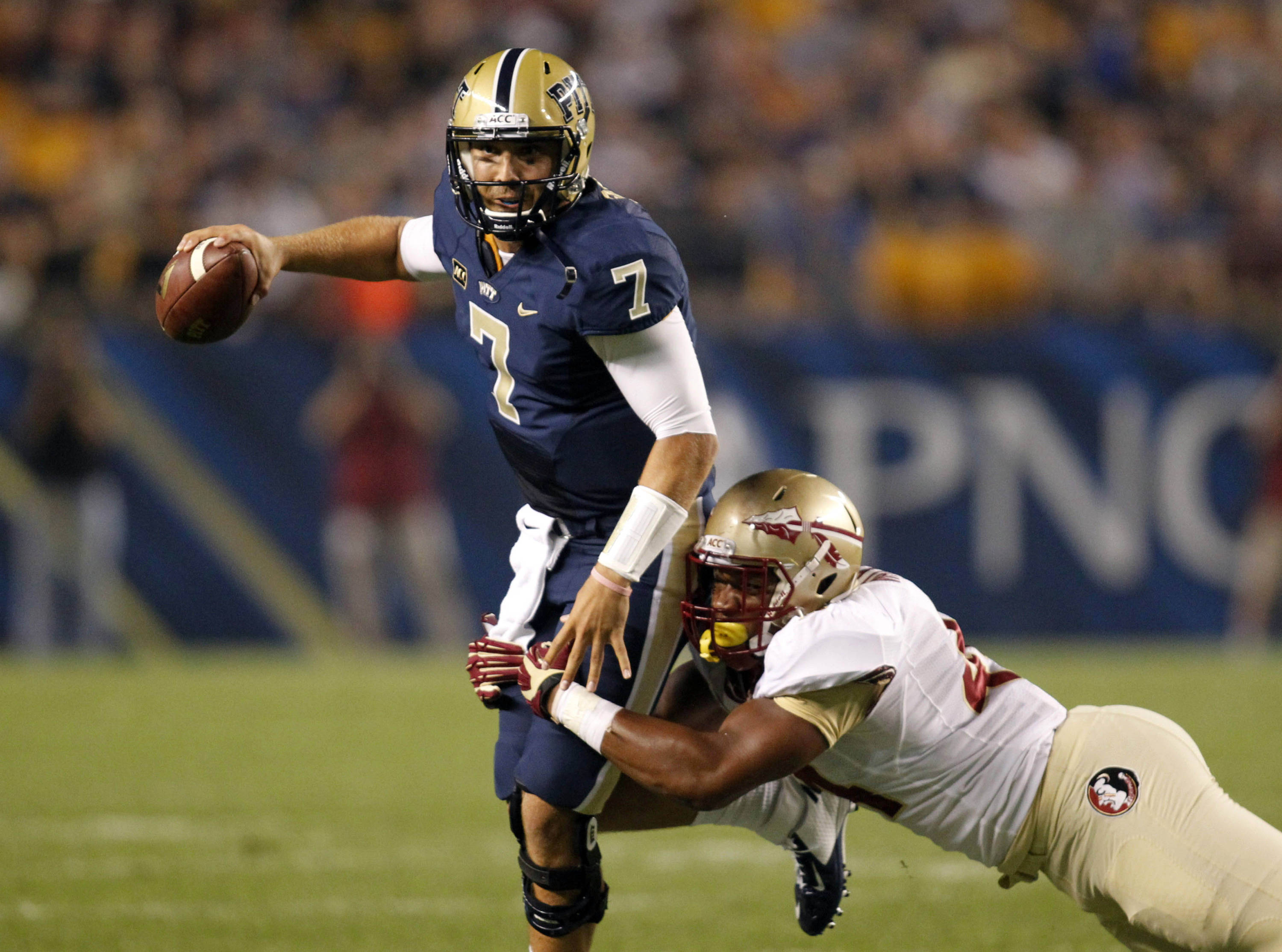 Pittsburgh Panthers quarterback Tom Savage (7) looks to pass under pressure from Florida State Seminoles defensive end DeMarcus Walker (44) during the first quarter at Heinz Field. Mandatory Credit: Charles LeClaire-USA TODAY Sports
