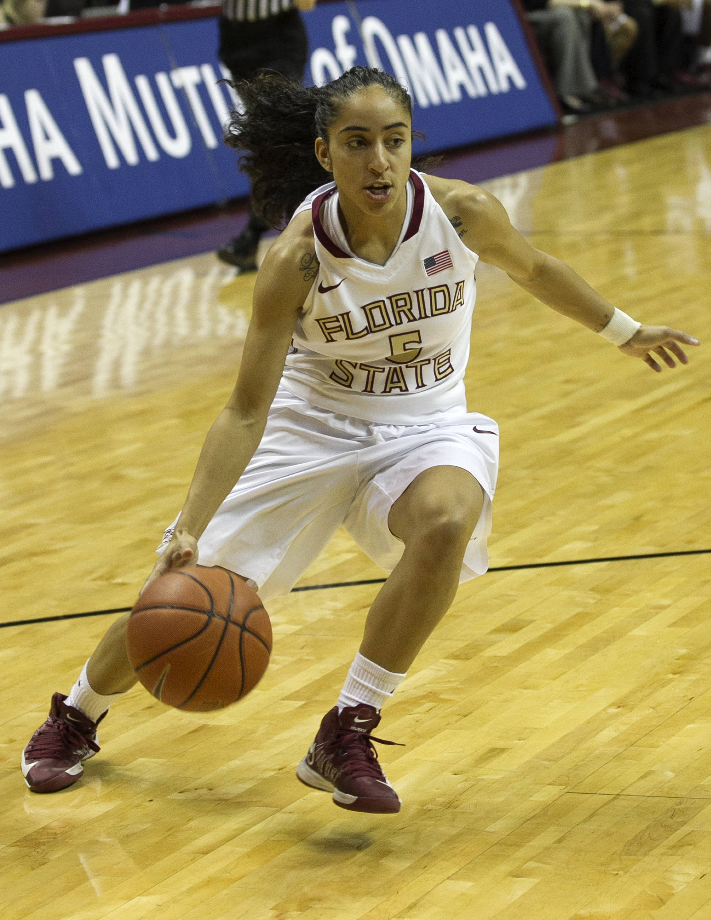 Cheetah Delgado (5) on a drive to the basket, FSU vs UT Martin, 12-28-13,  (Photo by Steve Musco)