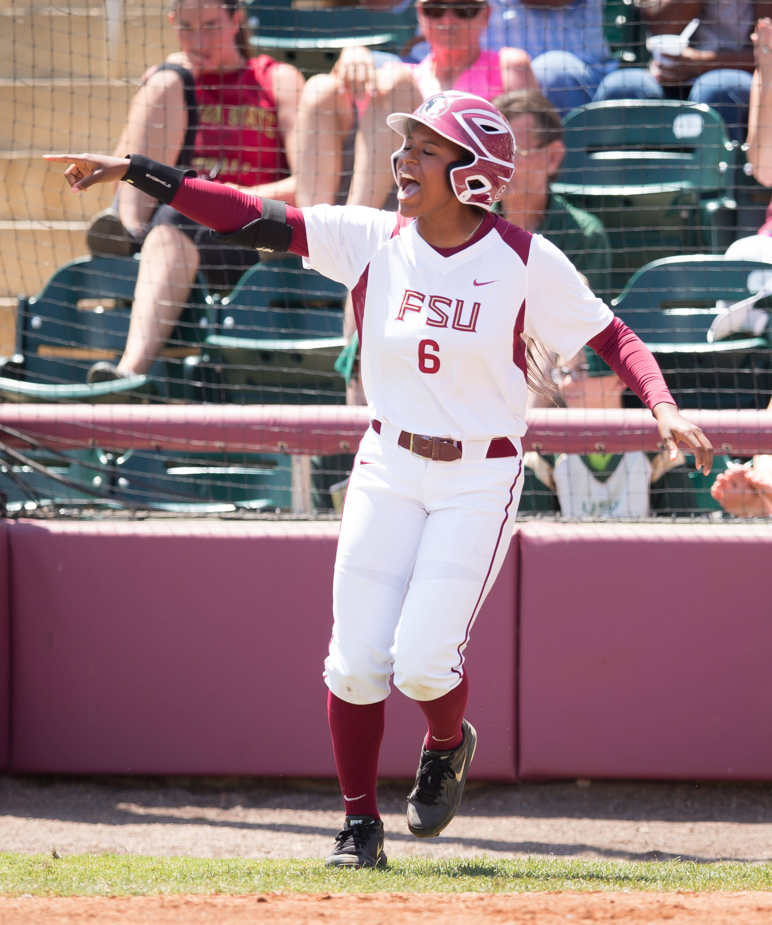 Tiffani Brown (6) celebrates scoring FSU's 1st run.