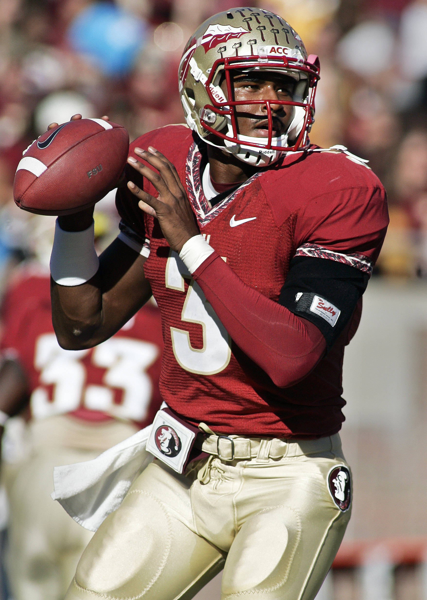 Florida State quarterback E.J. Manuel (3) warms up prior to an NCAA college football game against Miami on Saturday, Nov. 12, 2011, in Tallahassee, Fla. (AP Photo/Phil Sears)