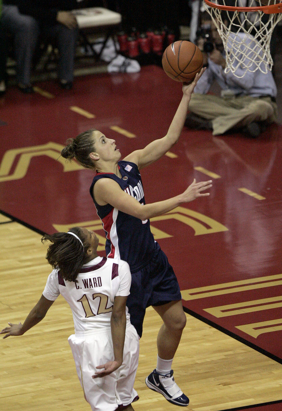 Connecticut's Caroline Doty drives the lane and scores past the defense of Florida State's Courtney Ward in the first half of an NCAA college basketball game Monday, Dec. 28, 2009, in Tallahassee, Fla. (AP Photo/Steve Cannon)