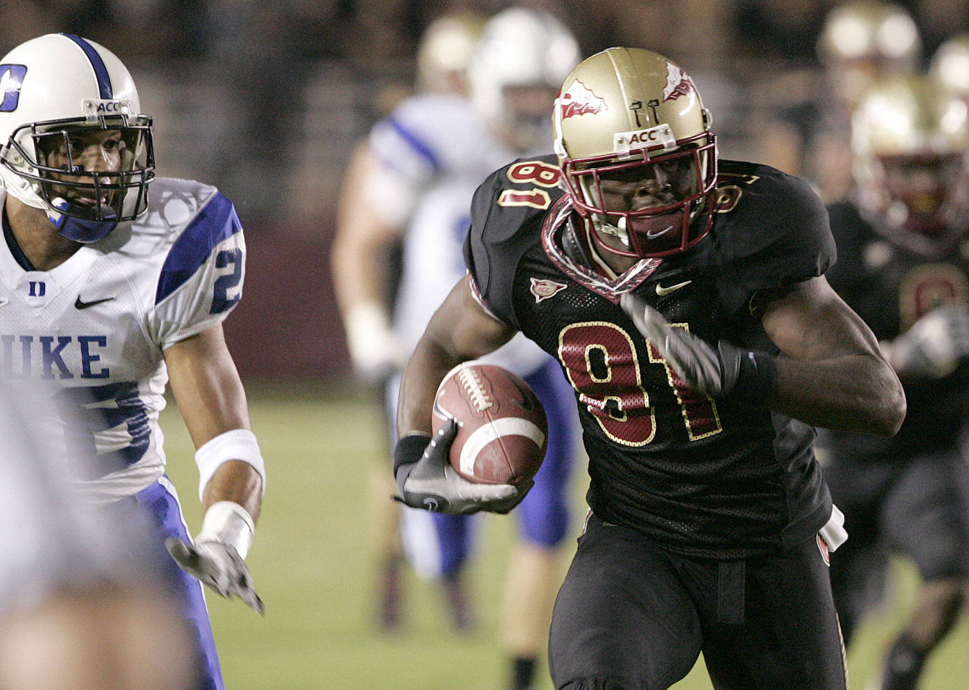 Florida State's Antone Smith runs for a long gain against Duke's defense. (AP Photo/Steve Cannon)