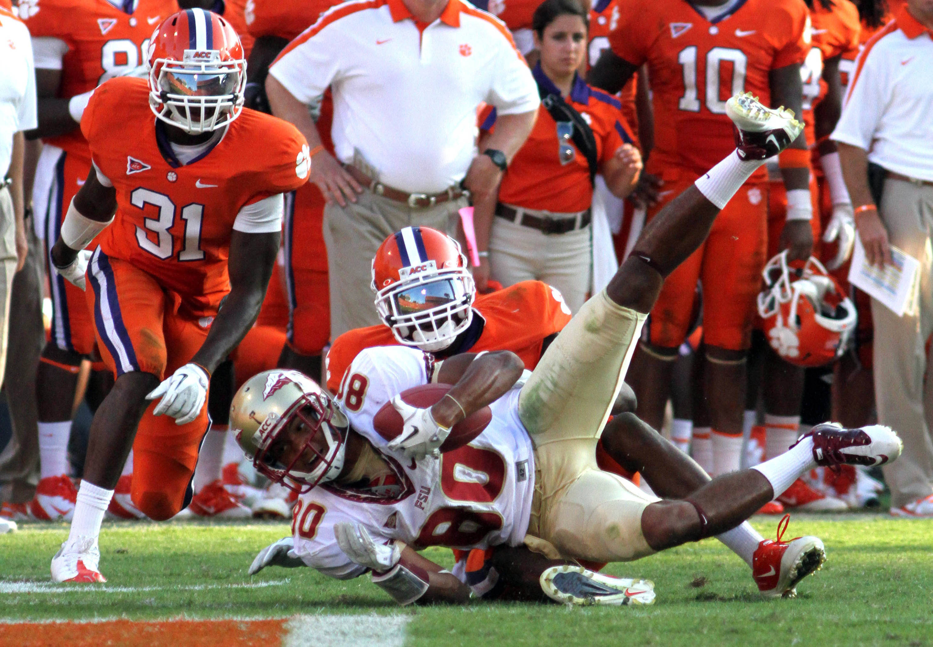 Sep 24, 2011; Clemson, SC, USA; Clemson Tigers cornerback Bashaud Breeland (17) brings down Florida State Seminoles wide receiver Rashad Greene (80) during the third quarter at Clemson Memorial Stadium. Tigers won 35-30. Mandatory Credit: Joshua S. Kelly-USA TODAY Sports