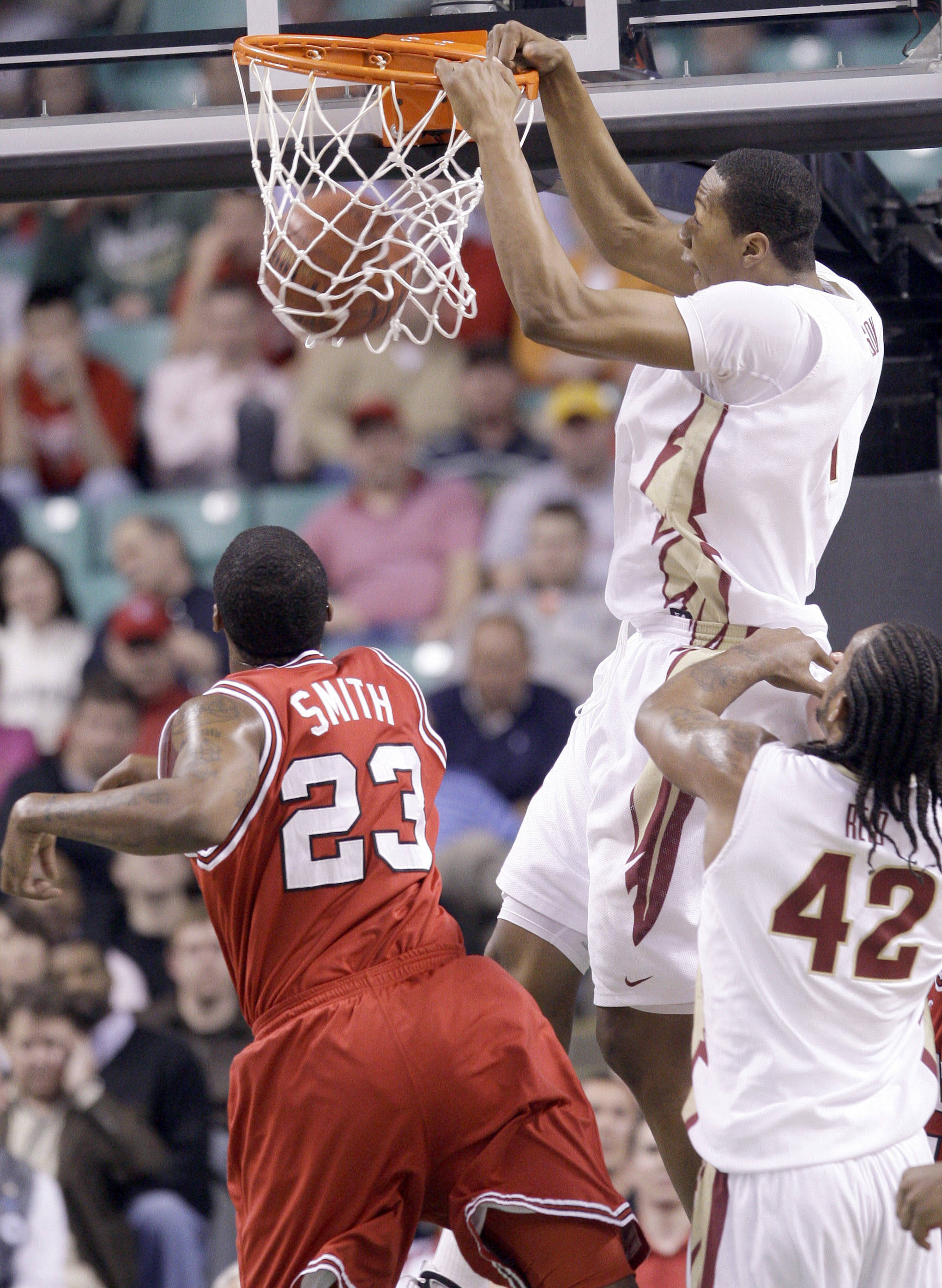 Florida State's Xavier Gibson (1) dunks the ball during the first half of an NCAA college basketball game against North Carolina State in the Atlantic Coast Conference tournament in Greensboro, N.C., Friday, March 12, 2010. (AP Photo/Chuck Burton)