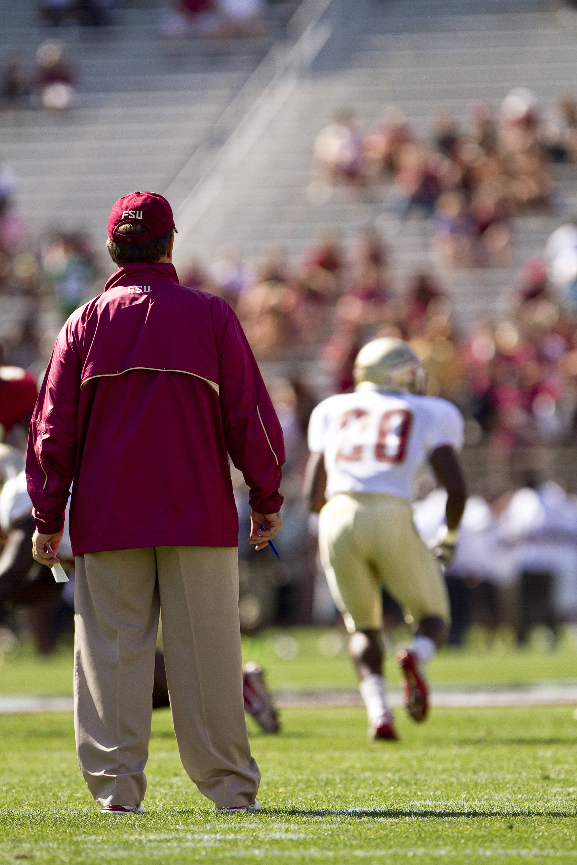 Jimbo Fisher watches the game on the field.