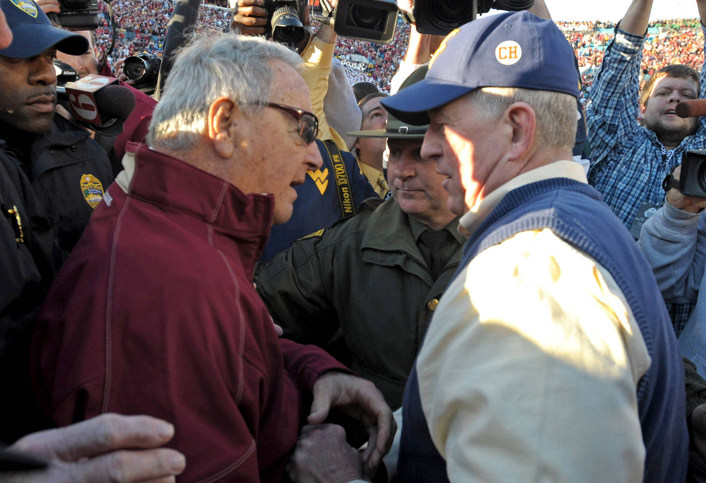 Bobby Bowden and Bill Stewart meet at midfield after the game
