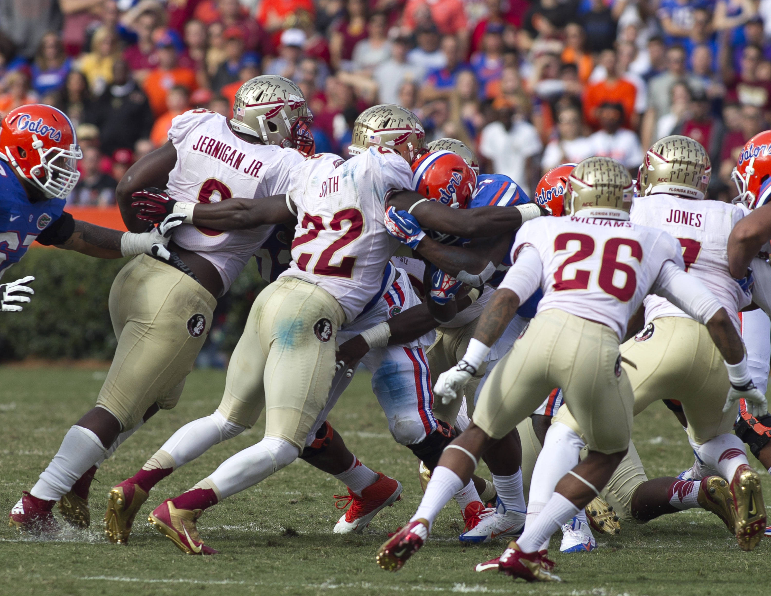 Swarming defensive tackles, FSU vs Florida, 11-30-13,  (Photo by Steve Musco)