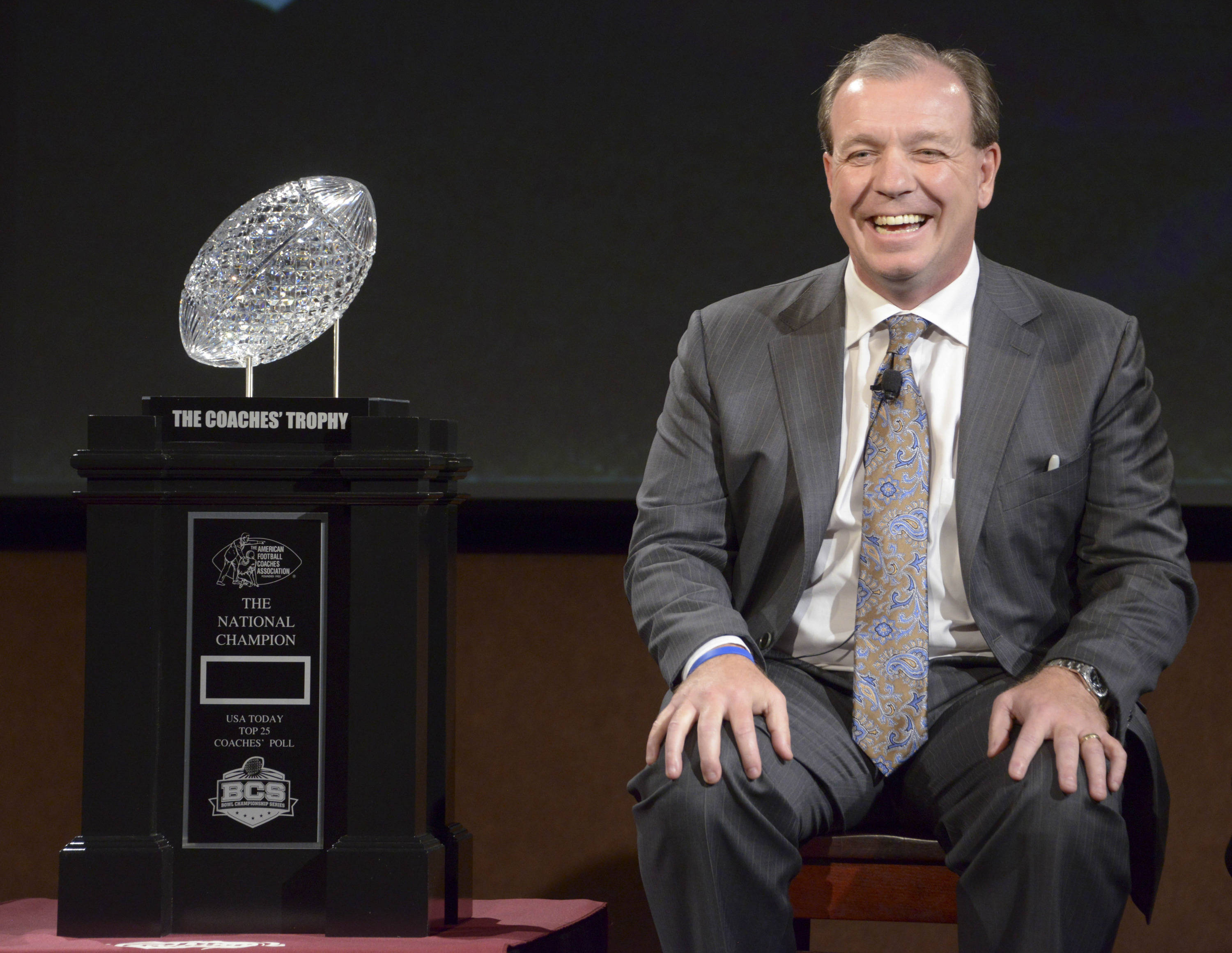 Florida State Seminoles coach Jimbo Fisher with the Coaches Trophy at a press conference for the 2014 BCS National Championship at ESPN Zone Downtown Disney. Mandatory Credit: Kirby Lee-USA TODAY Sports