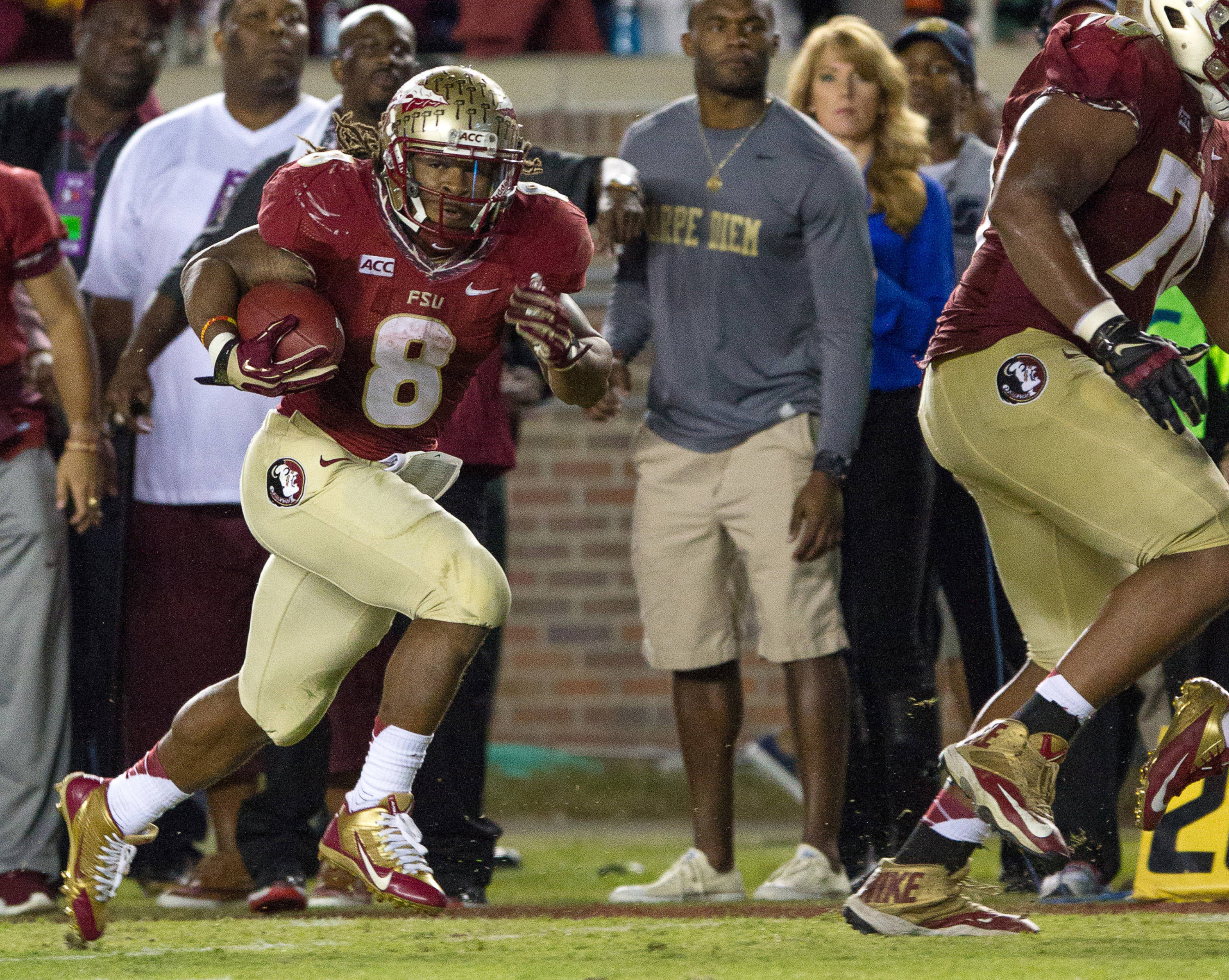 Devonta Freeman (8) runs the ball during FSU football's 41-14 win over Miami on Saturday, November 2, 2013 in Tallahassee, Fla. Photo by Michael Schwarz.