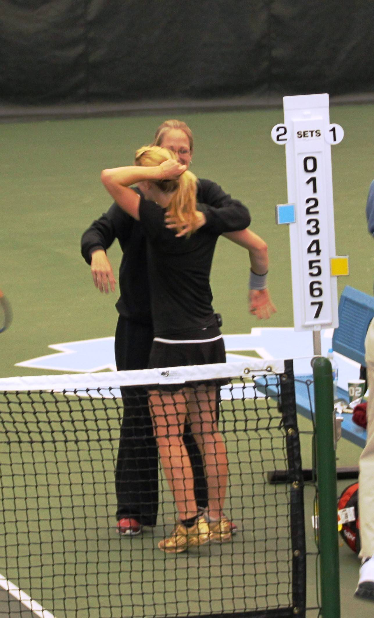 Head Coach Jennifer Hyde gives Ruth Seaborne a hug after clinching the match.