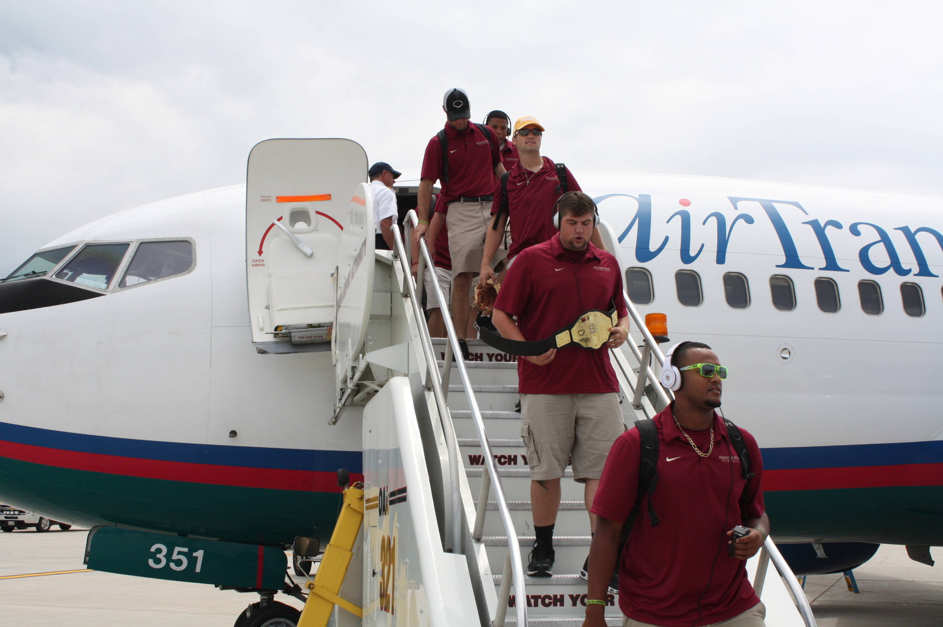 The Seminoles departing the plane in Omaha.