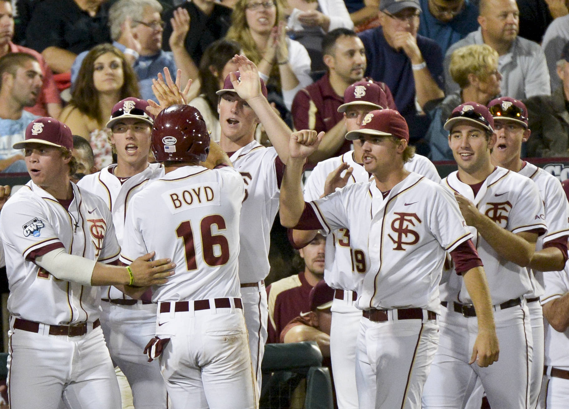 Florida State's Jayce Boyd (16), celebrates with teammates after he scored on a hit by John Holland. (AP Photo/Ted Kirk)