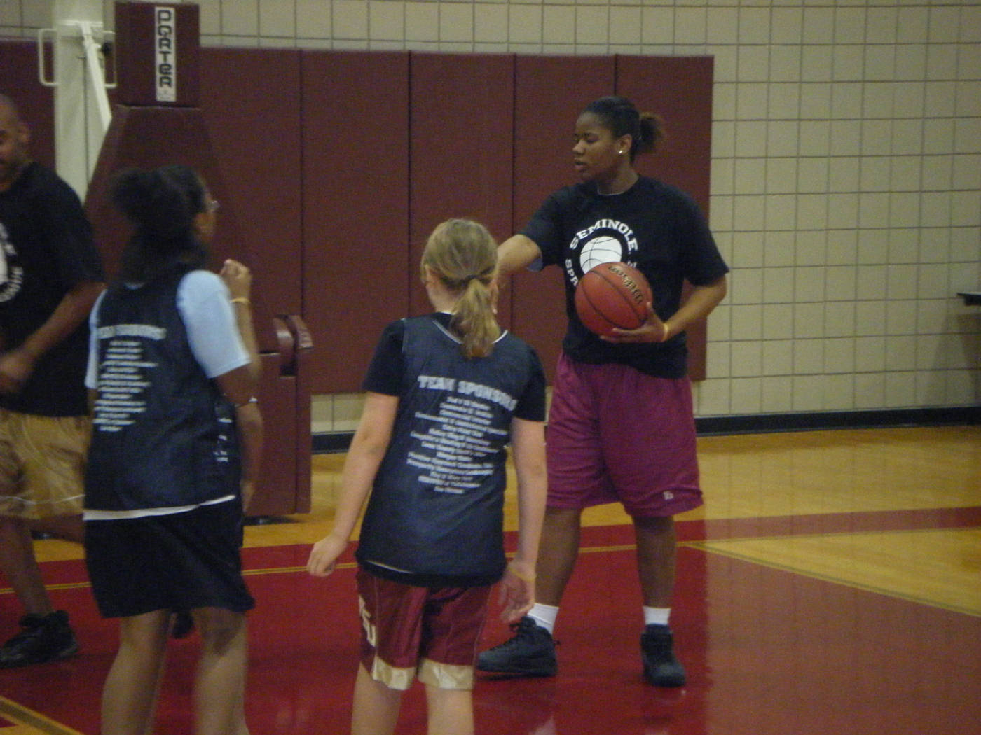 Freshman Antionette Howard teaches the girls how to correctly pass a ball.