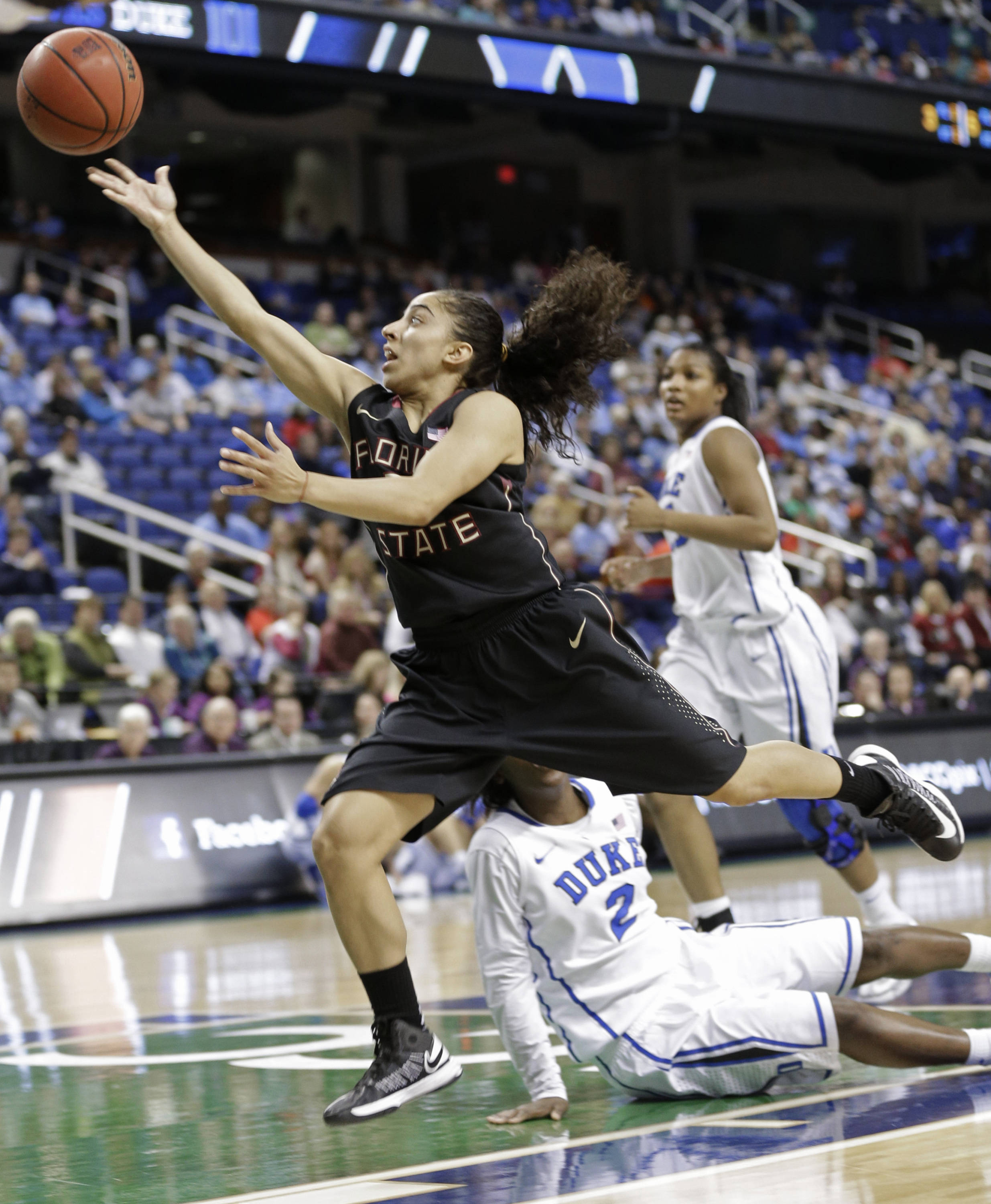 Florida State's Yashira Delgado (5) drives past Duke's Alexis Jones (2). (AP Photo/Chuck Burton)