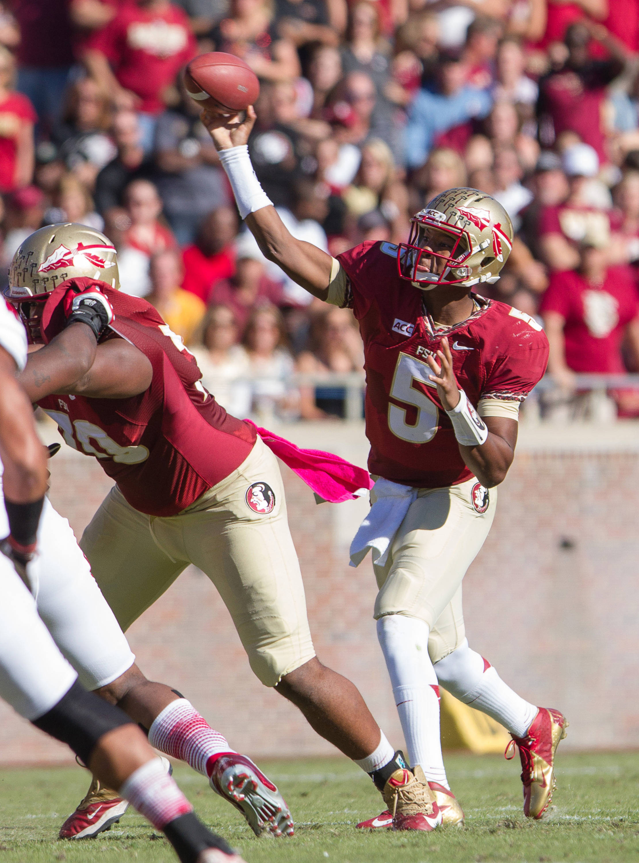 Jameis Winston (5) makes a pass during FSU Football's 49-17 win over NC State on Saturday, October 26, 2013 in Tallahassee, Fla. Photo by Michael Schwarz.