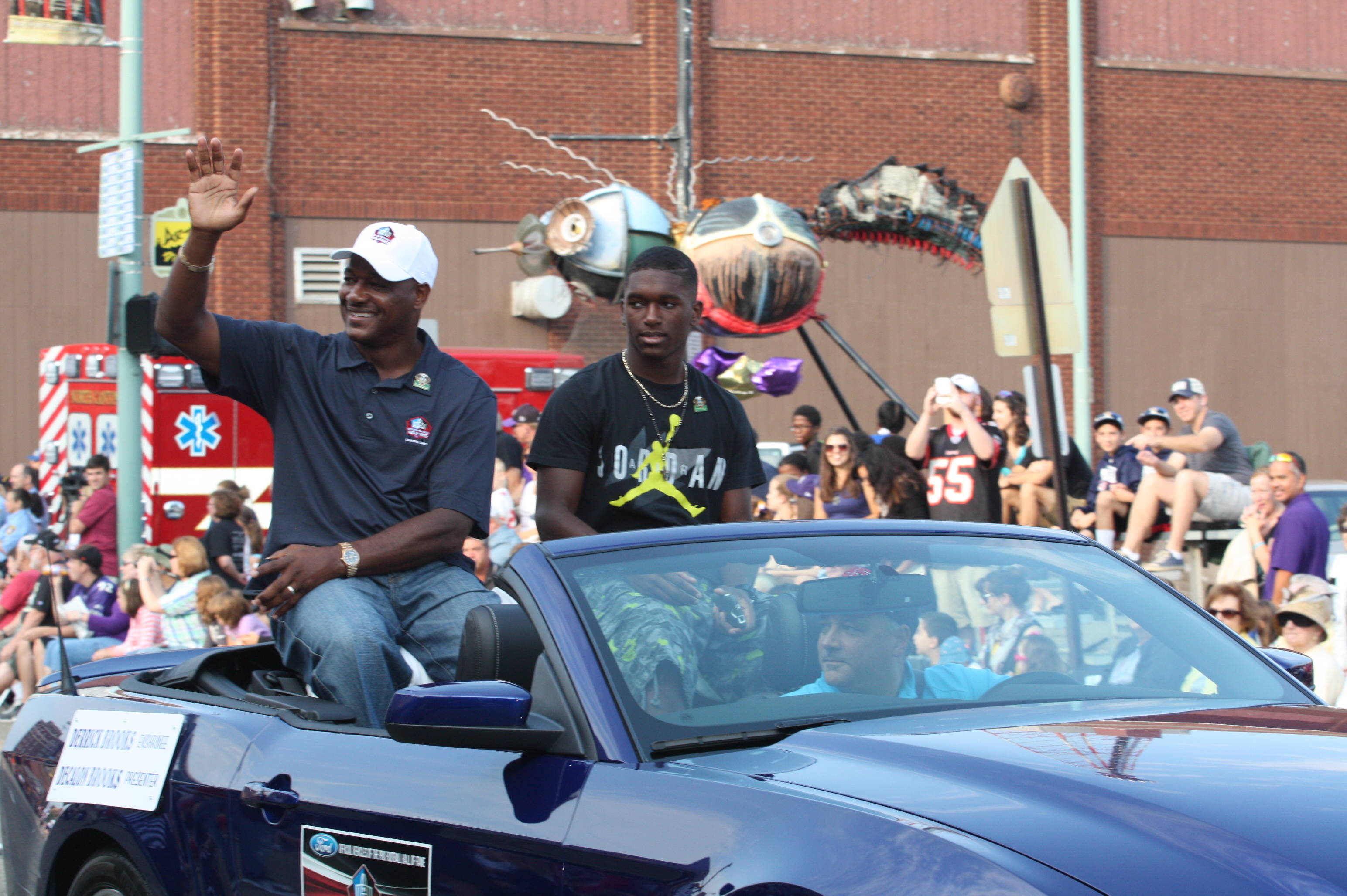 Derrick Brooks & his son Decalon ride in the HOF parade Saturday morning.