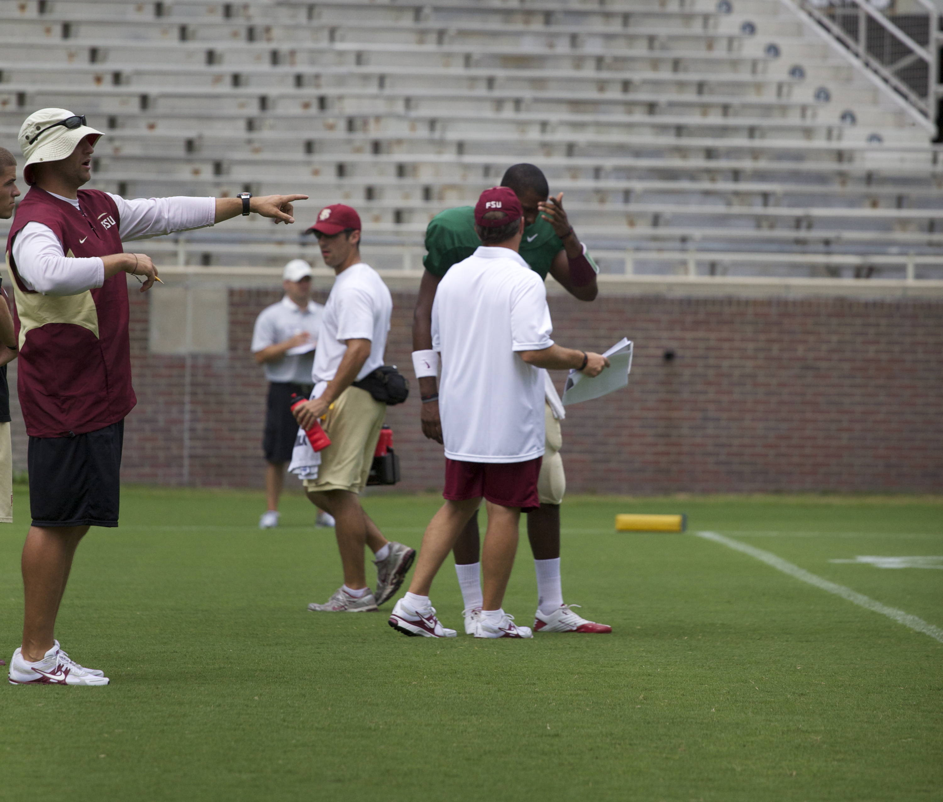 EJ Manuel (3) talking with Coach Fisher.