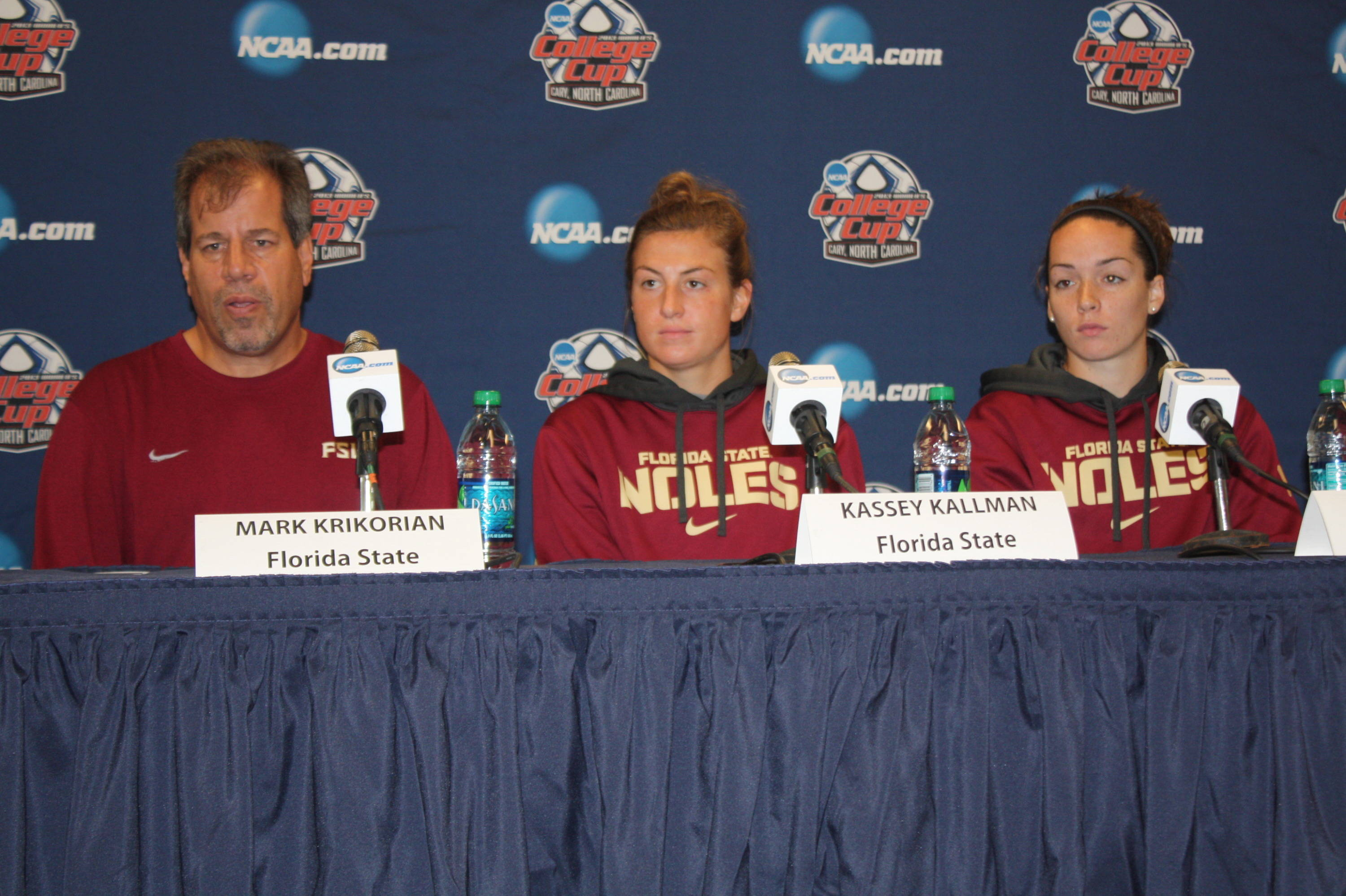 Head coach Mark Krikorian, Kassey Kallman and Kelsey Wys speak to the media during the pre-tournament press conference.