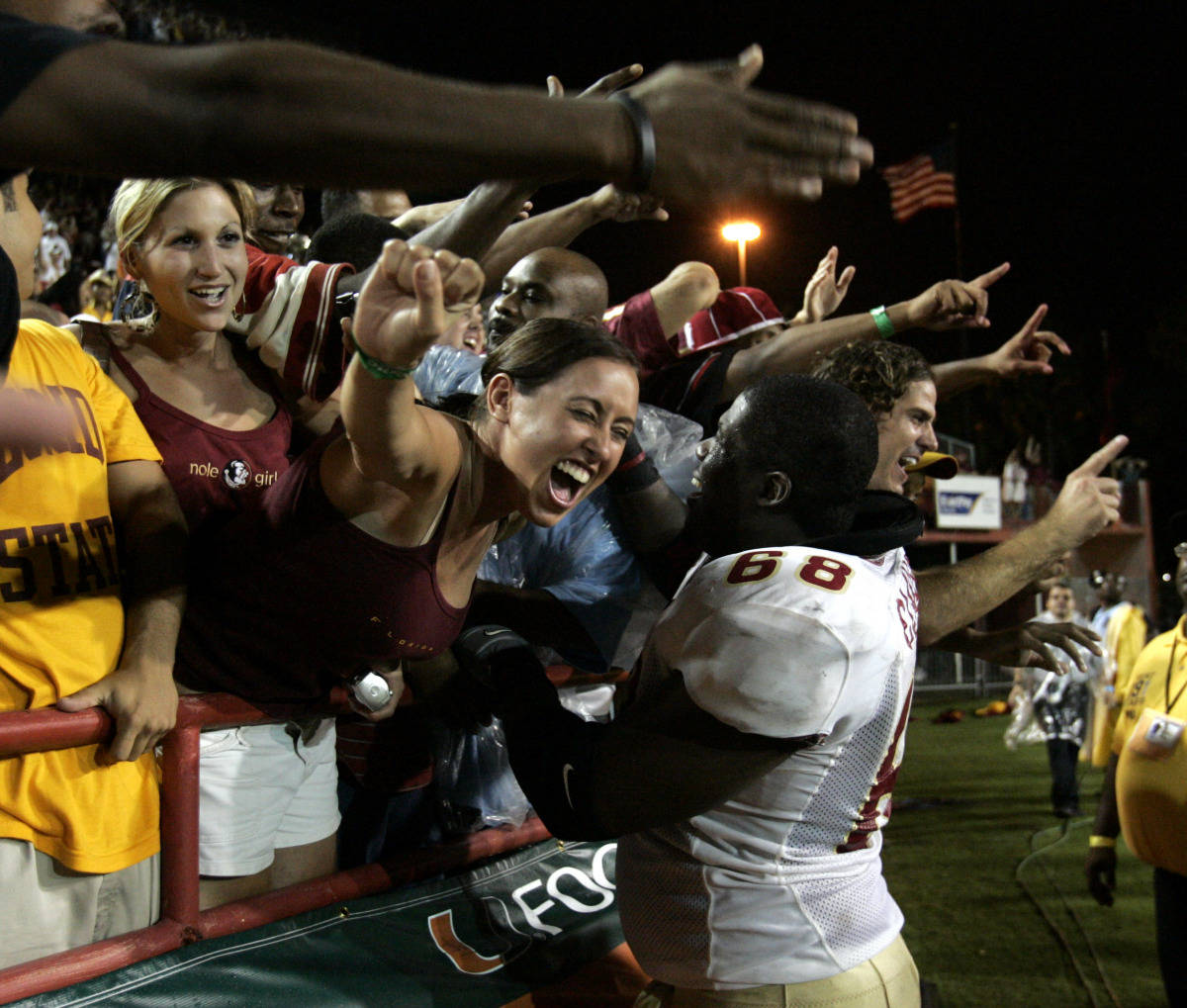 Florida State offensive guard Jacky Claude, right, celebrates Florida State's 13-10 victory over Miami with fans Monday, Sept. 4, 2006 at the Orange Bowl in Miami. (AP Photo/Lynne Sladky)
