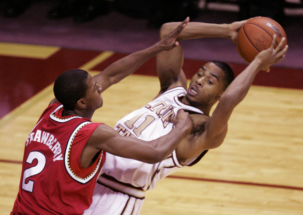 Florida State's Jerel Allen, right, attempts to make a first-half pass as Maryland's D. J. Strawberry defends during a college basketball game, Tuesday, Jan. 30, 2007, in Tallahassee, Fla.(AP Photo/Phil Coale)