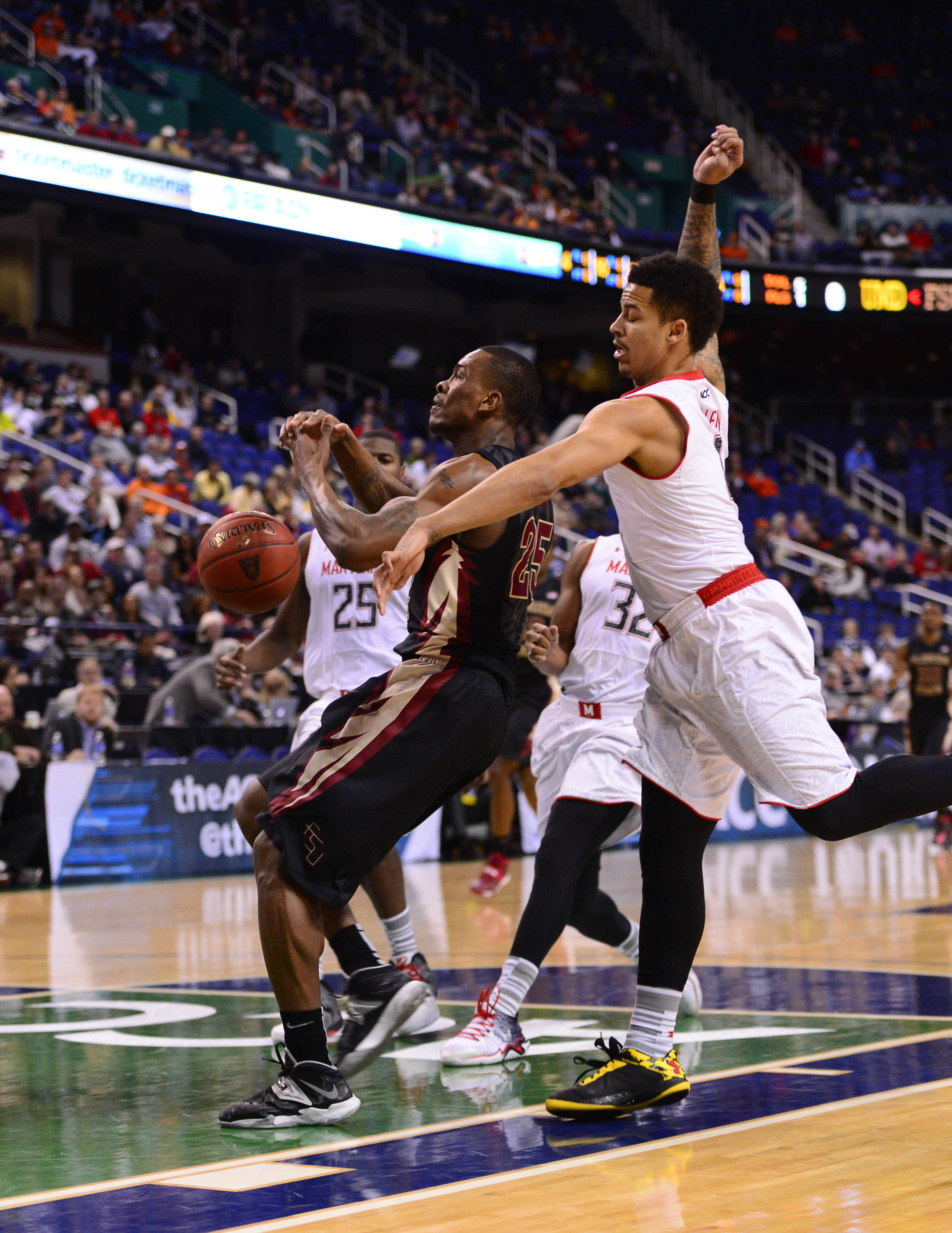 Maryland Terrapins guard Seth Allen (4) knocks the ball free from Florida State Seminoles guard Aaron Thomas (25) in the first half in the second round of the ACC college basketball tournament at Greensboro Coliseum. Mandatory Credit: Bob Donnan-USA TODAY Sports