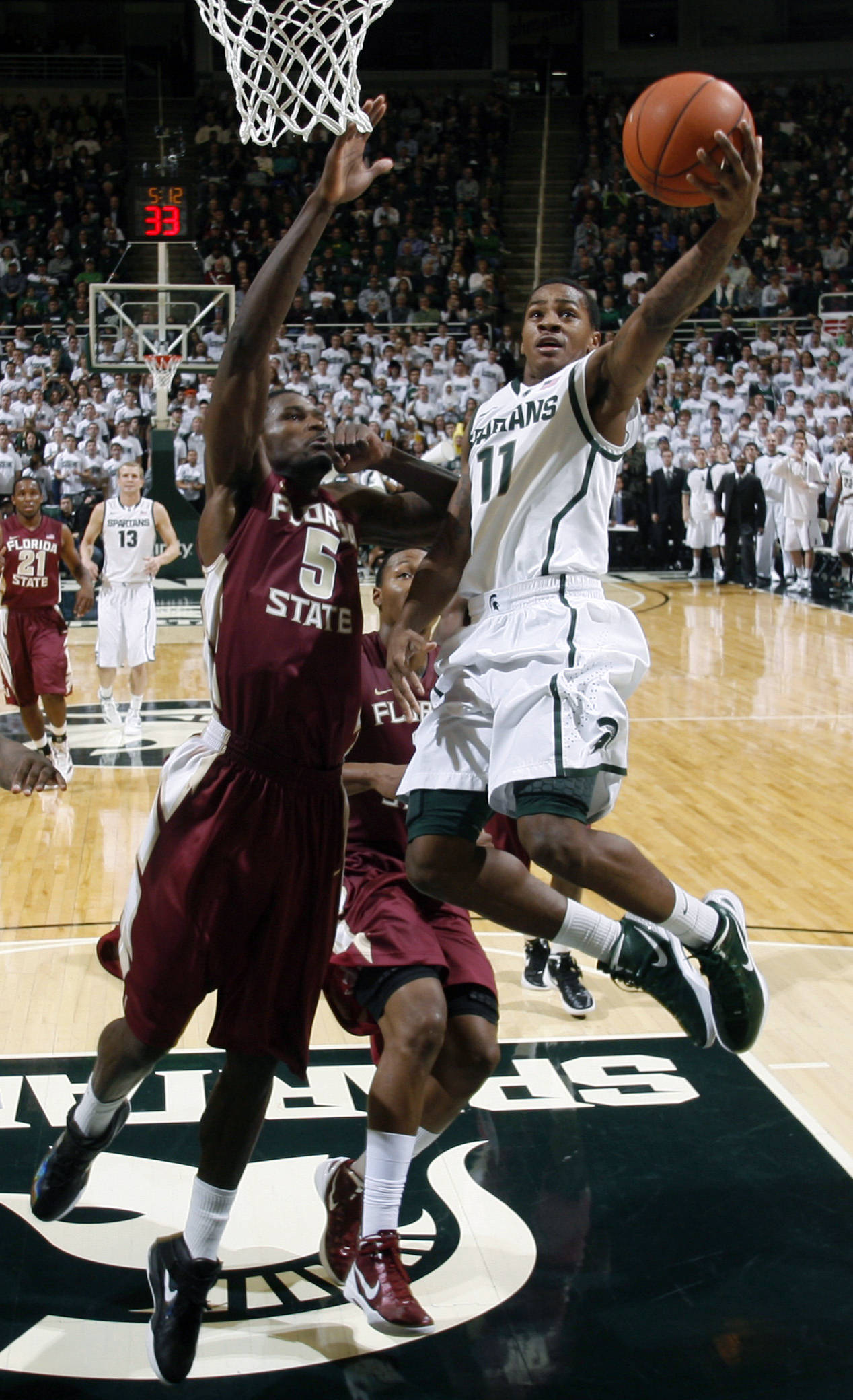 Michigan State's Keith Appling puts up a layup against Florida State's Bernard James during the first half. (AP Photo/Al Goldis)
