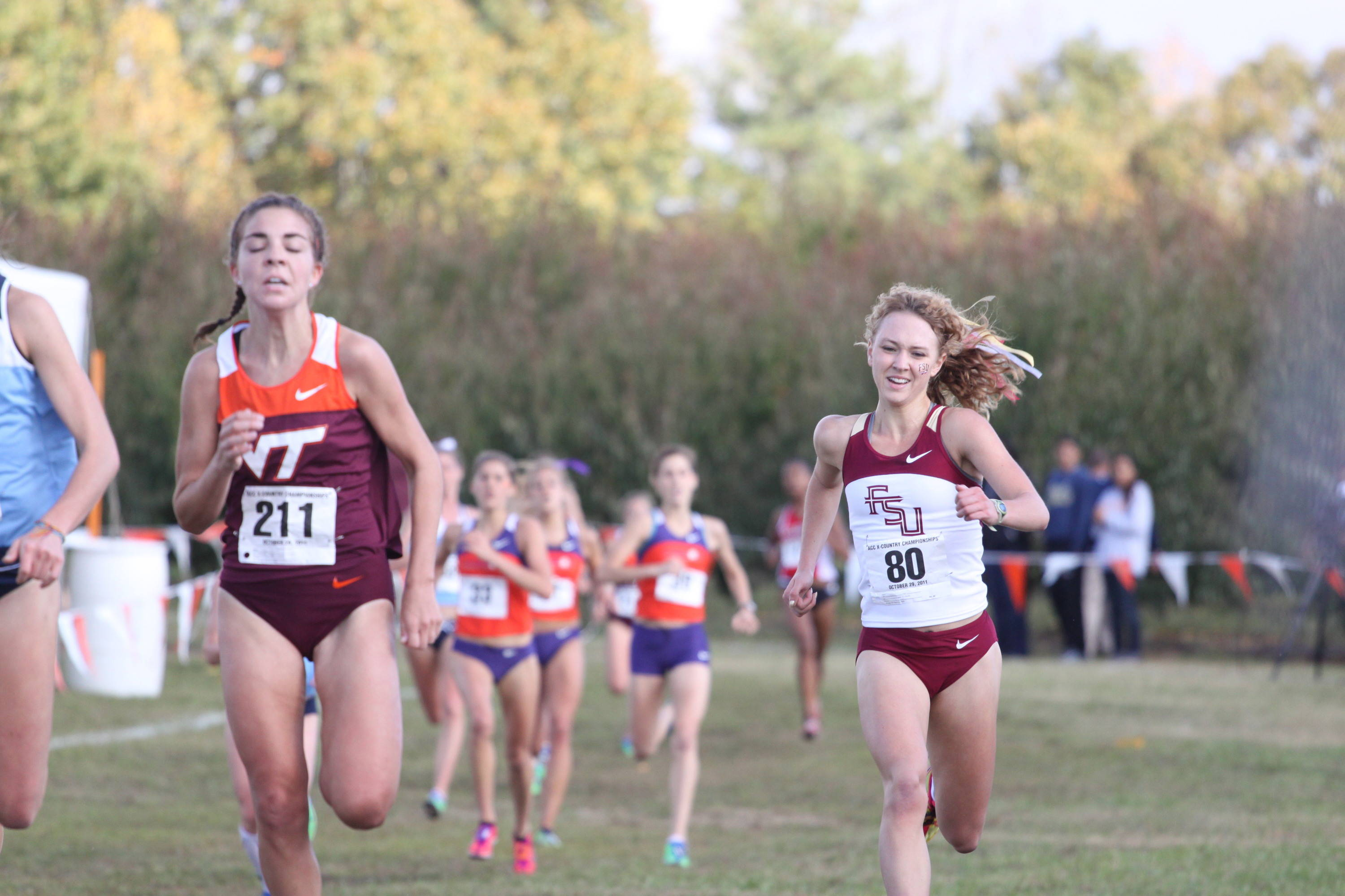 Freshman Aubree Worden (right) kicks to a strong finish at the ACC Championships.