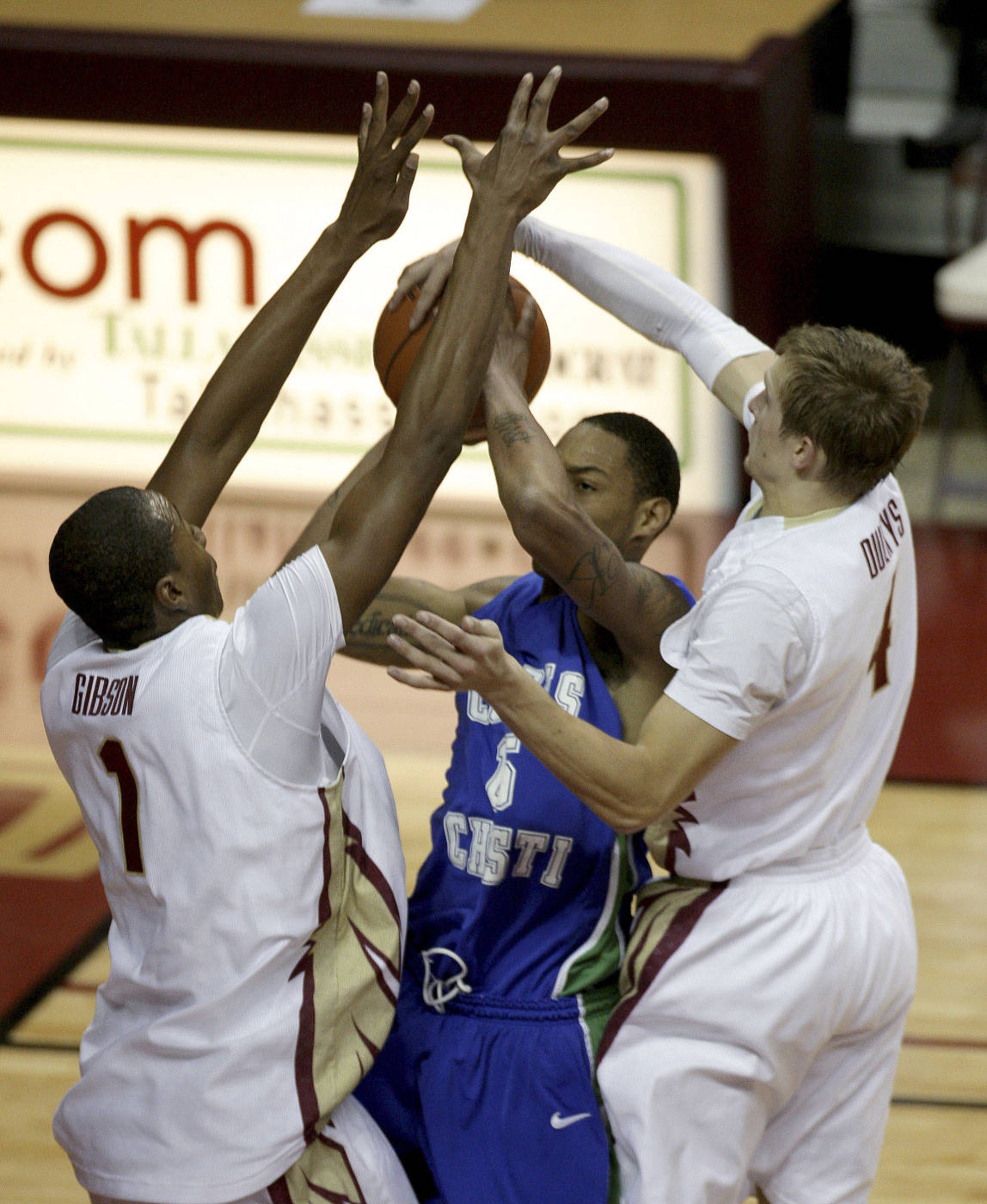 Texas A&M-Corpus Christi's Kevin Palmer, center, has his first-half shot blocked by Florida State's Deividas Dulkys, right, as Pierre Jordan, left, helps on defense during an NCAA college basketball game Monday, Jan. 4, 2010, in Tallahassee, Fla. (AP Photo/Phil Coale)