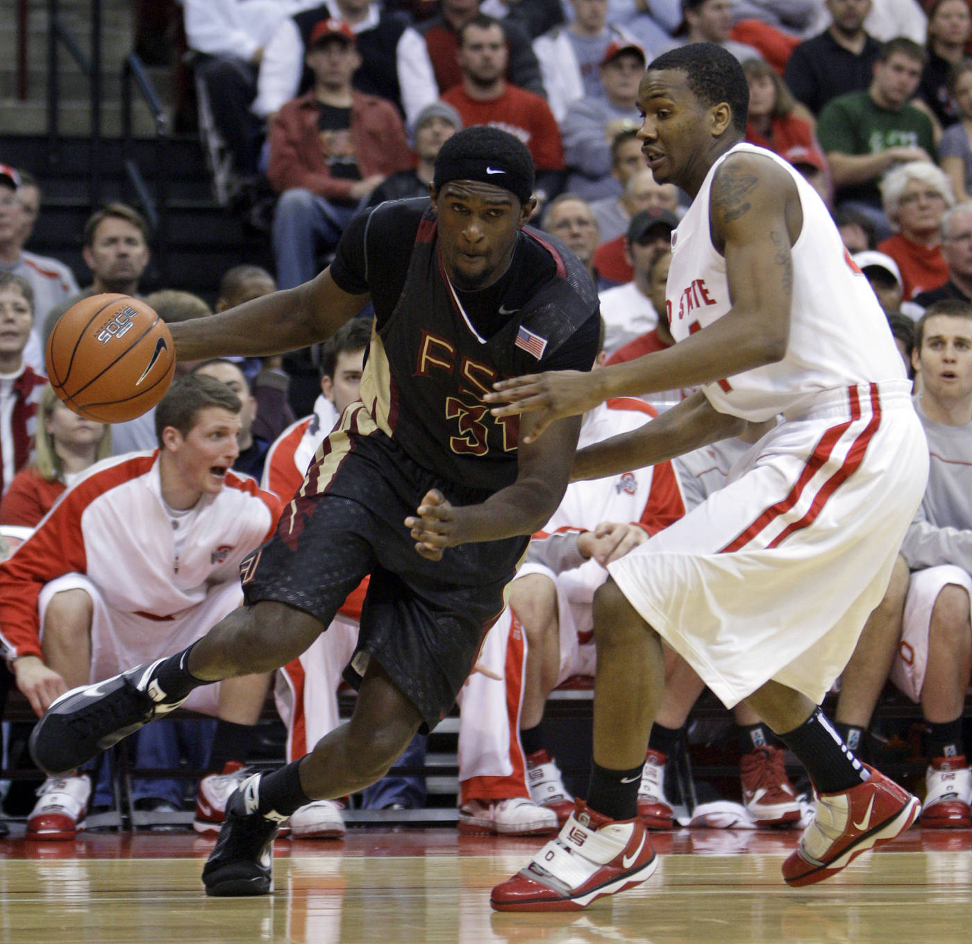 Florida State's Chris Singleton, left, drives to the basket against Ohio State's William Buford during the first half.