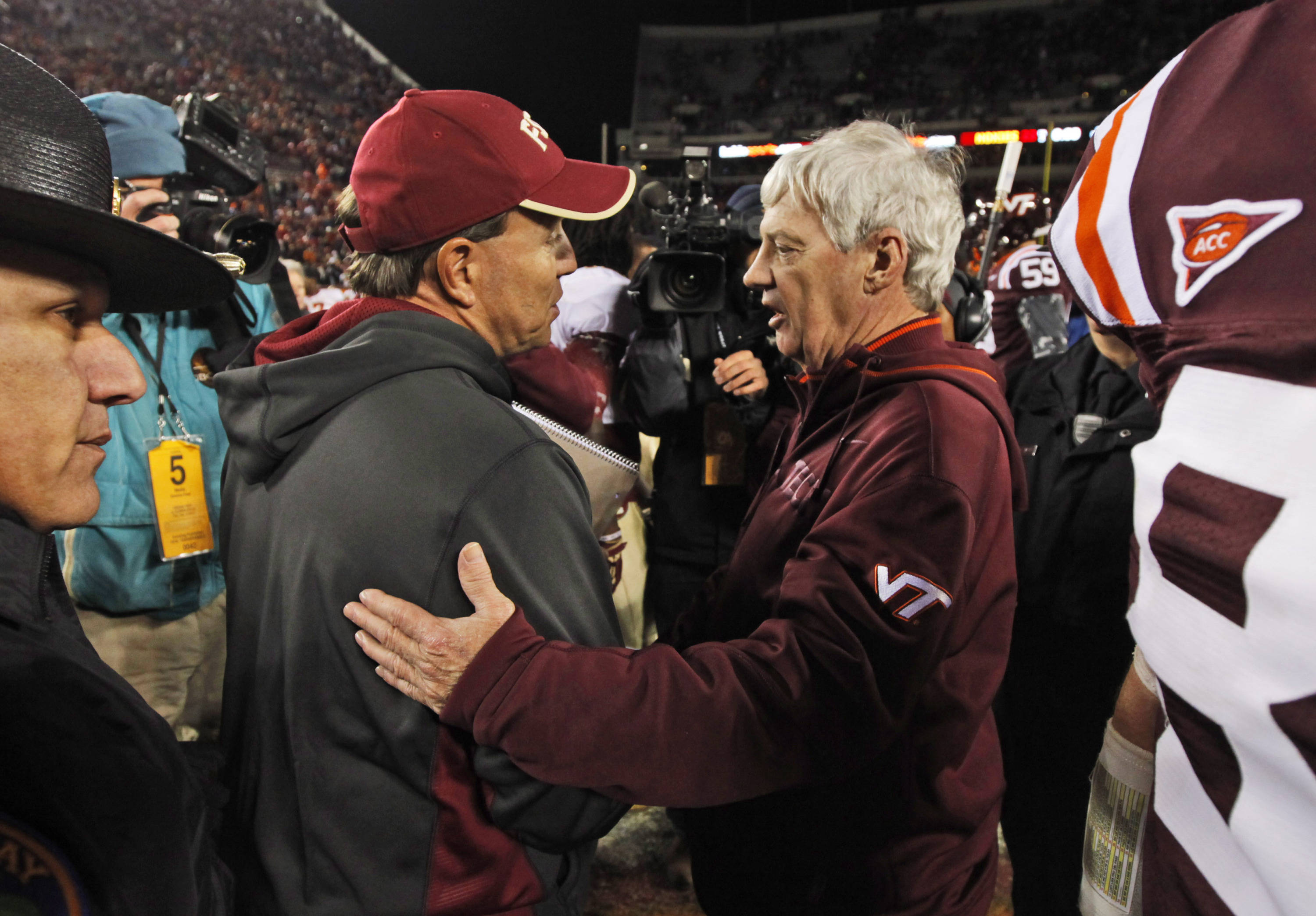Florida State coach Jimbo Fisher, left, and Virginia coach, Frank Beamer greet each other after the game. (AP Photo/Steve Helber)
