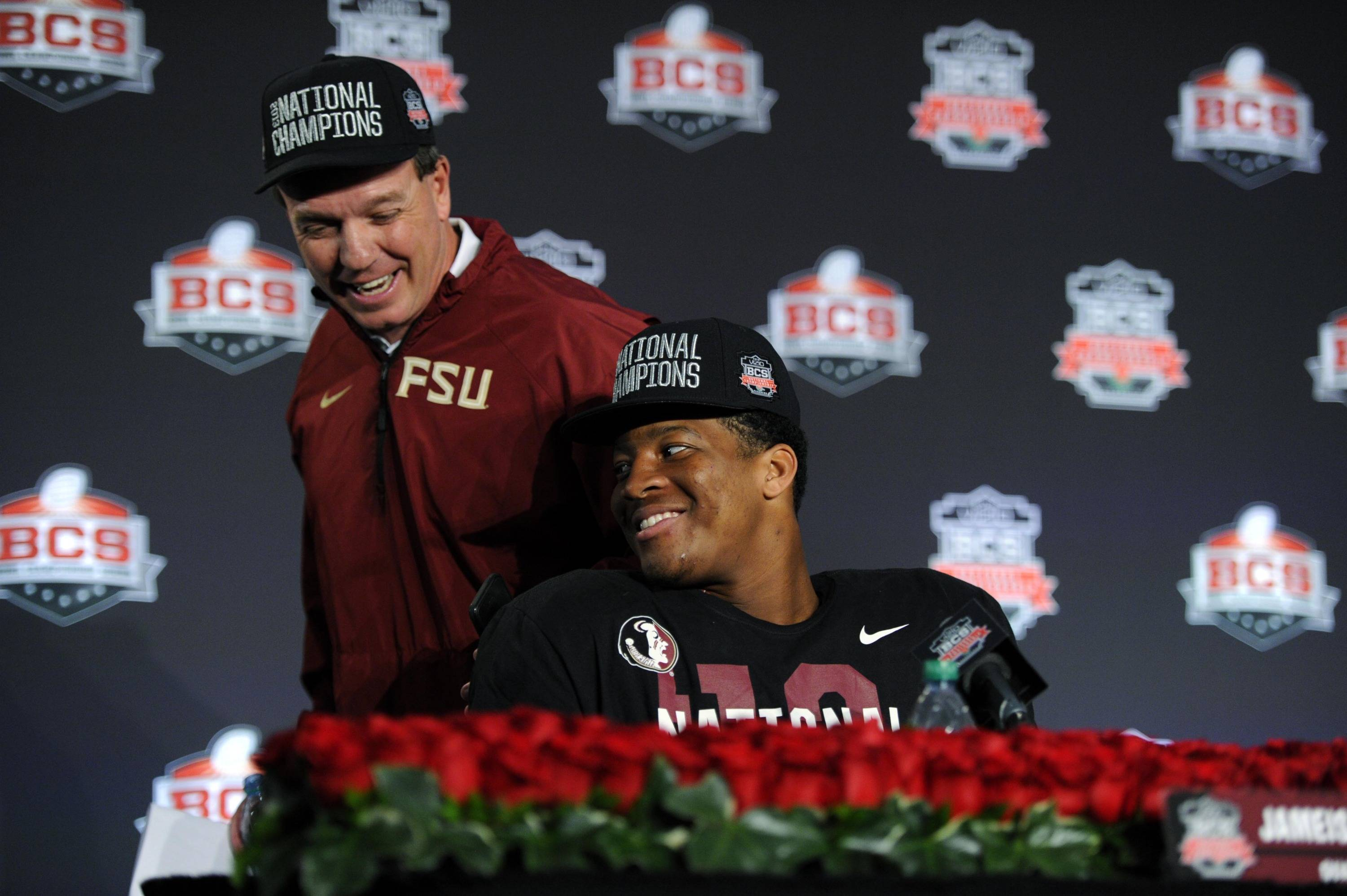 Jan 6, 2014; Pasadena, CA, USA; Florida State Seminoles head coach Jimbo Fisher (left) walks past quarterback Jameis Winston (right) at a press conference after the 2014 BCS National Championship game against the Auburn Tigers at the Rose Bowl.  Mandatory Credit: Kirby Lee-USA TODAY Sports