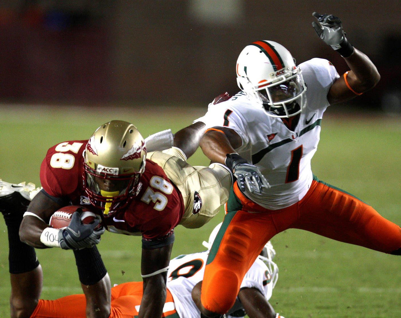 Florida State's Jermaine Thomas, left, dives for first-quarter yardage as Miami's Brandon Harris makes the tackle during an NCAA college football game Monday, Sept. 7, 2009, in Tallahassee, Fla. (AP Photo/Phil Coale)