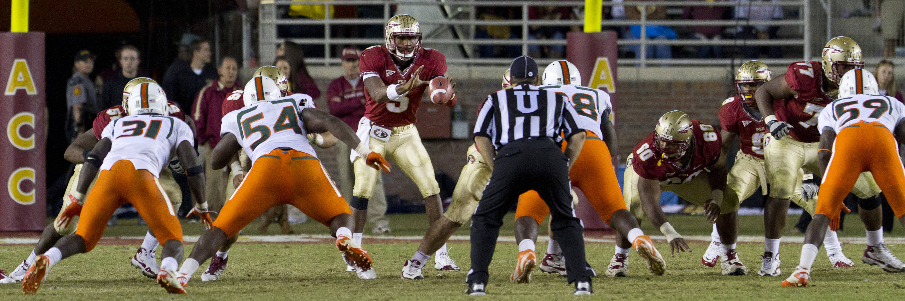 EJ Manuel (3) receives the snap during the football game against Miami on November 12, 2011.