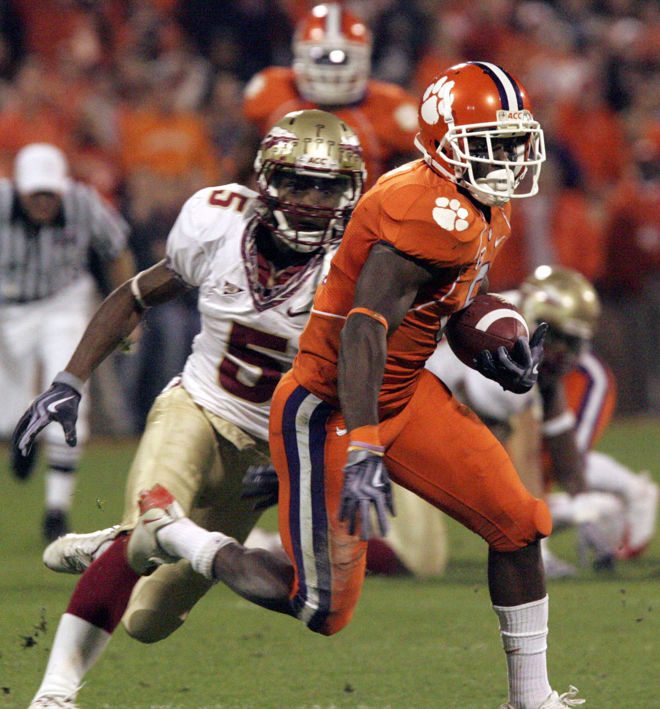 Clemson's Jacoby Ford (6) runs for a first down as Florida State's Greg Reid (5) tries to stop during the first half. (AP Photo/Mary Ann Chastain)