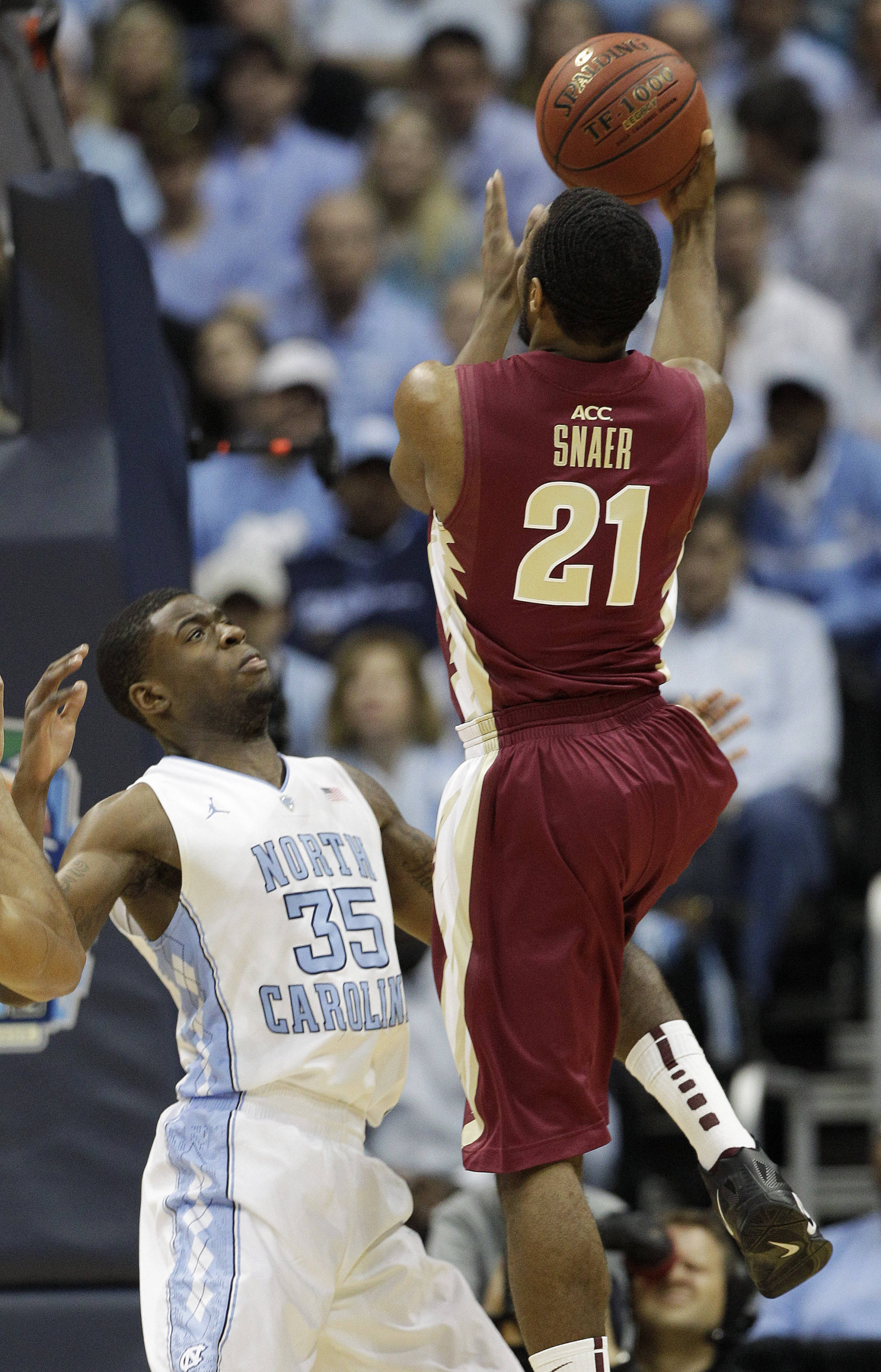 Michael Snaer shoots over North Carolina Tar Heels guard Reggie Bullock.. (AP Photo/Chuck Burton)