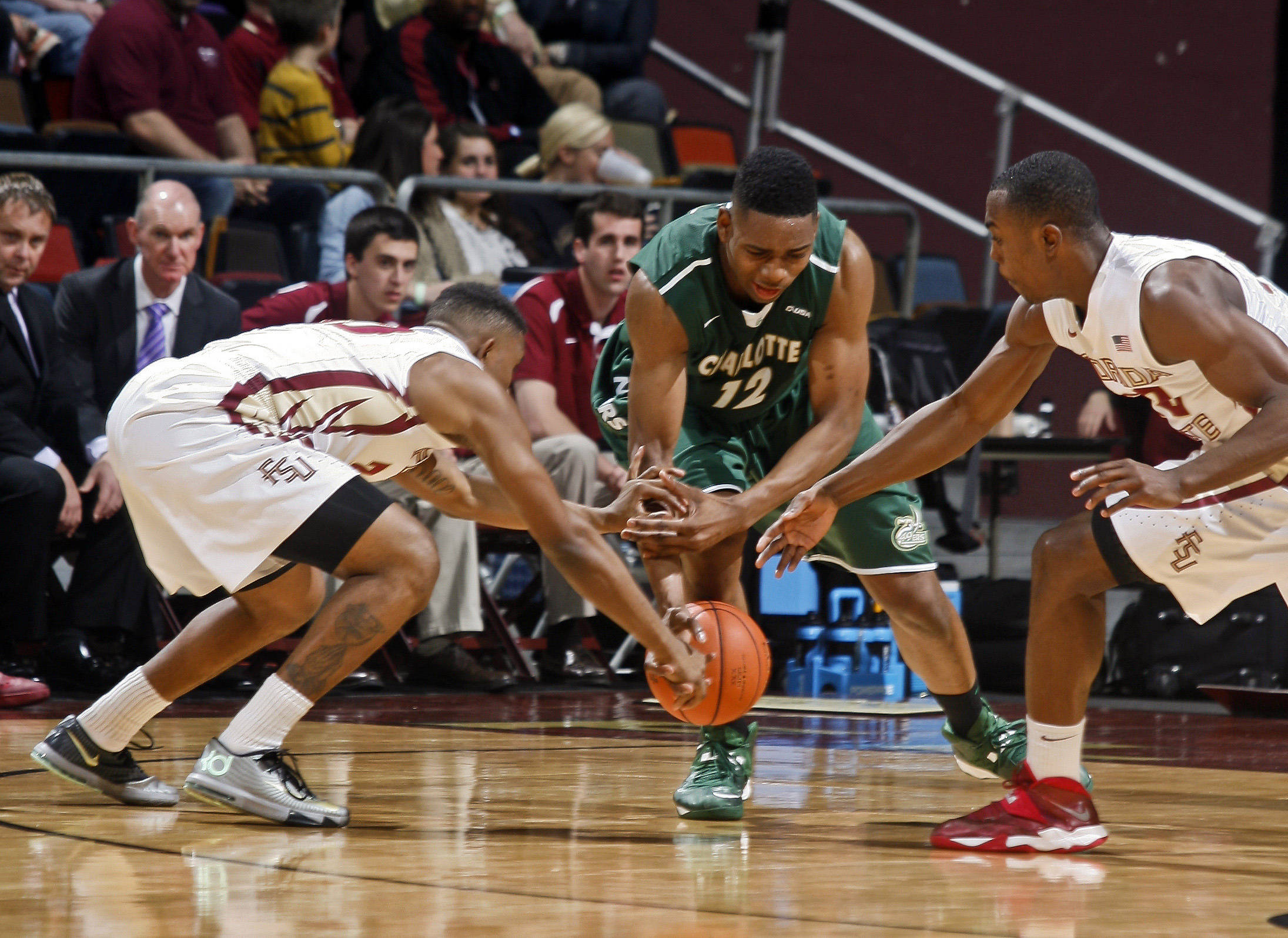 Dec 17, 2013; Tallahassee, FL, USA; Florida State Seminoles guard Ian Miller (30) and Charlotte 49ers center Mike Thorne Jr. (12) and Florida State Seminoles guard Montay Brandon (32) go for a loose ball in the first half of their game at the Donald L. Tucker Center. Mandatory Credit: Phil Sears-USA TODAY Sports