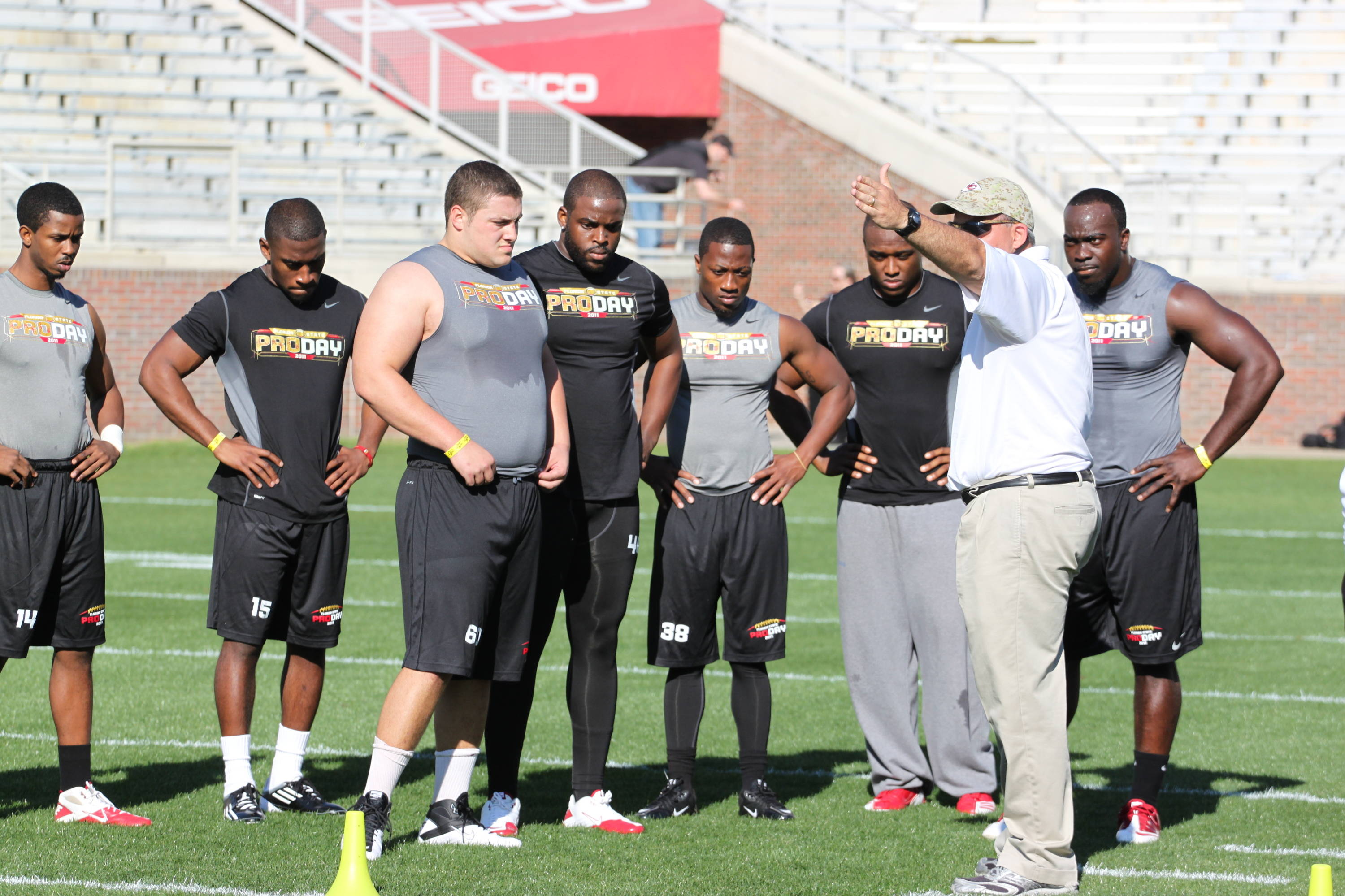 Players getting instructions before the start of Pro Day.