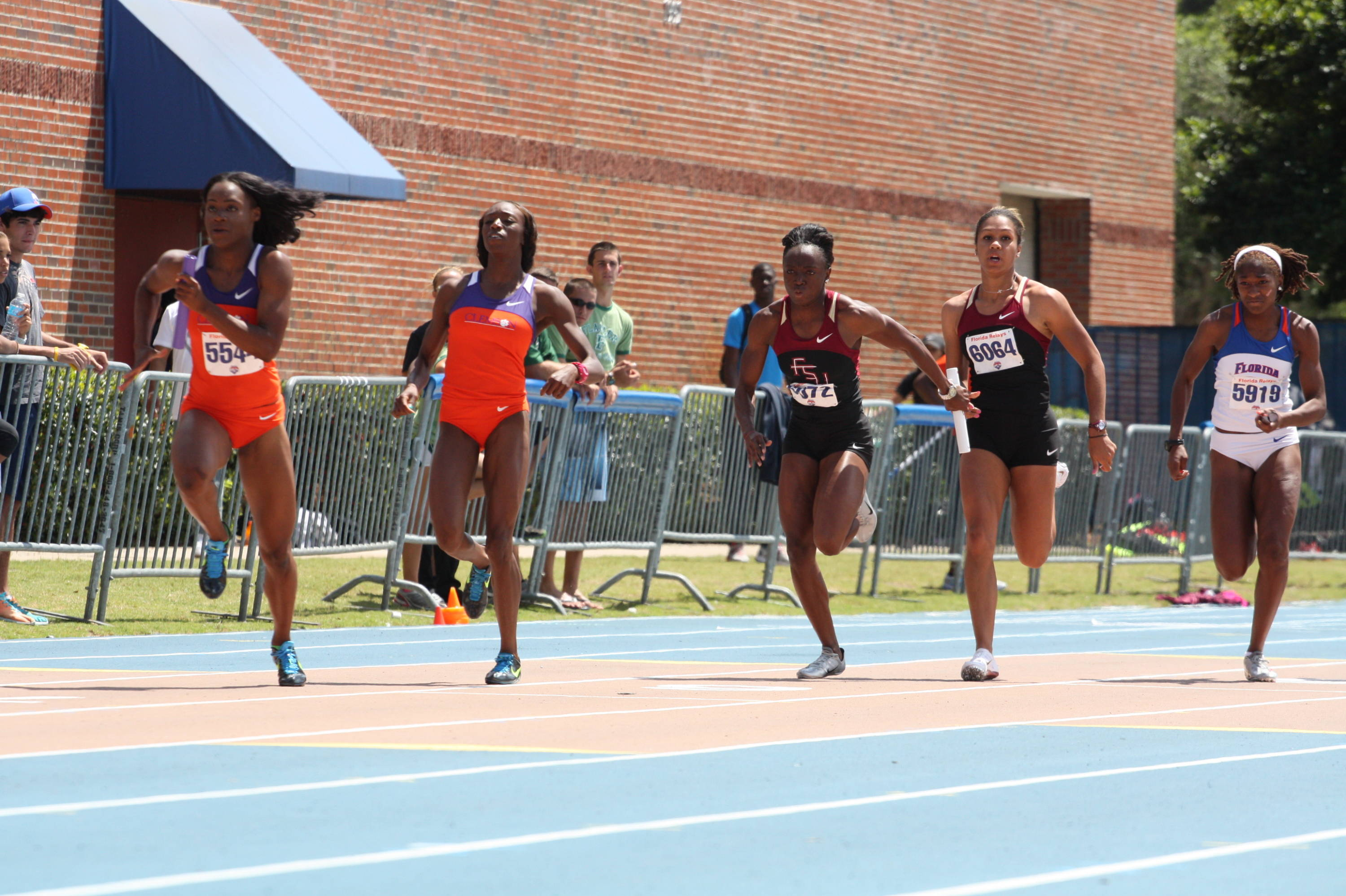 Marecia Pemberton gets the baton from Amy Harris and as the 'Noles are flanked by Clemson and Florida in the 4x100.