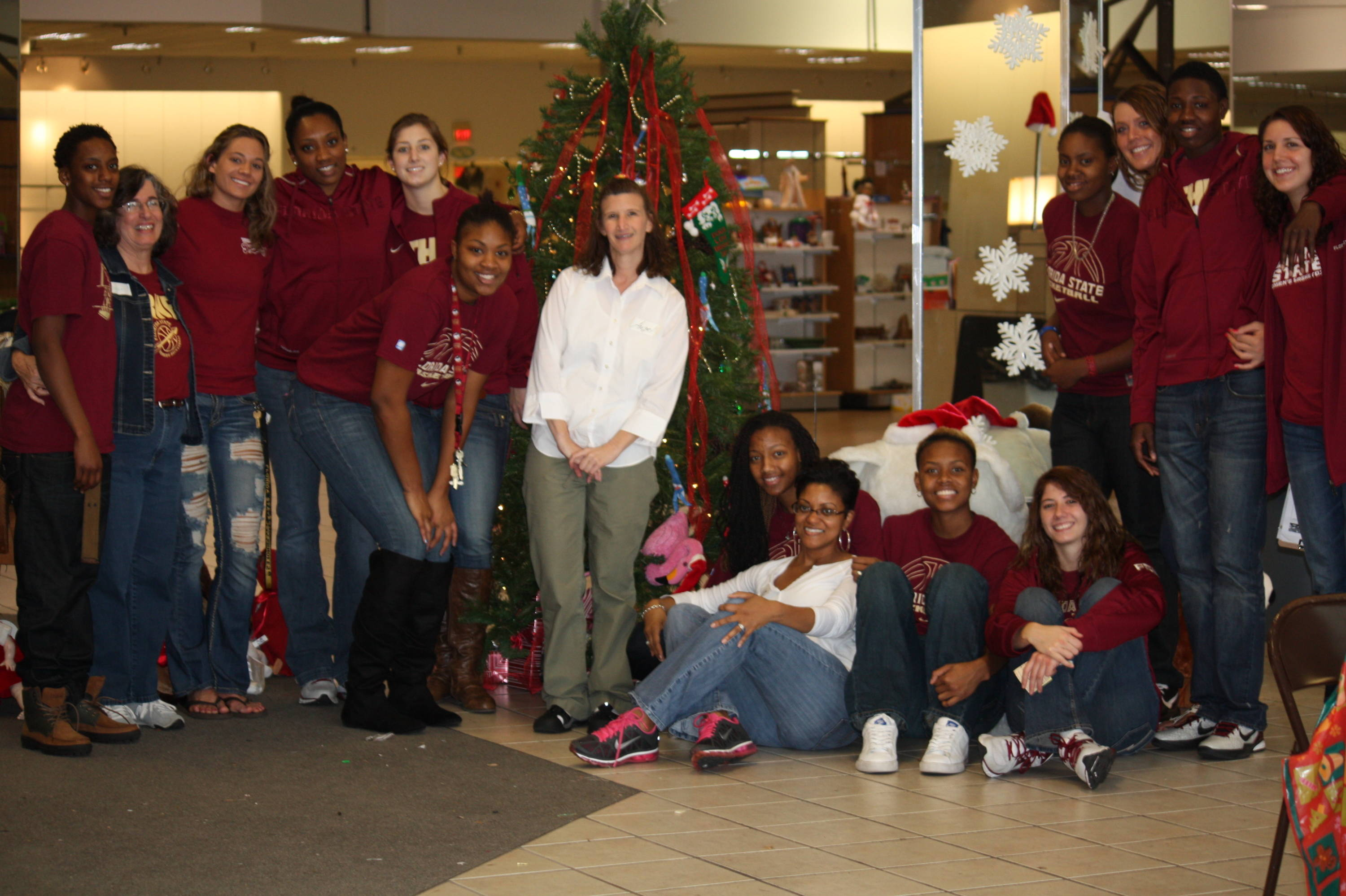 The entire FSU women's hoops team poses with Christmas Connection volunteers.