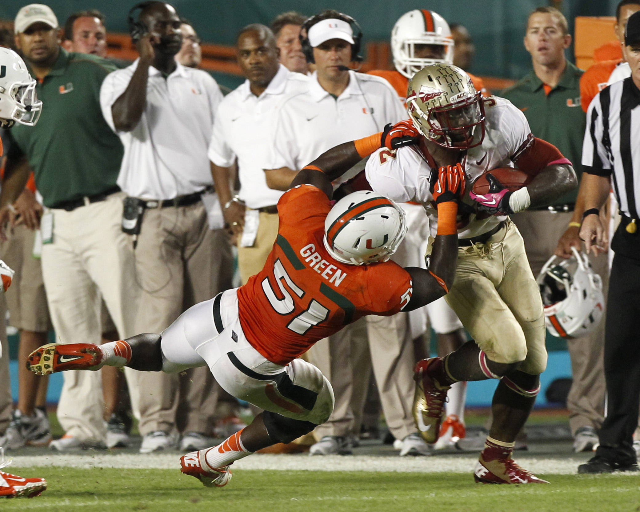 Florida State's James Wilder Jr., right, is tackled by Miami's Shayon Green (51) during the first half of an NCAA college football game in Miami, Saturday, Oct. 20, 2012. (AP Photo/Alan Diaz)