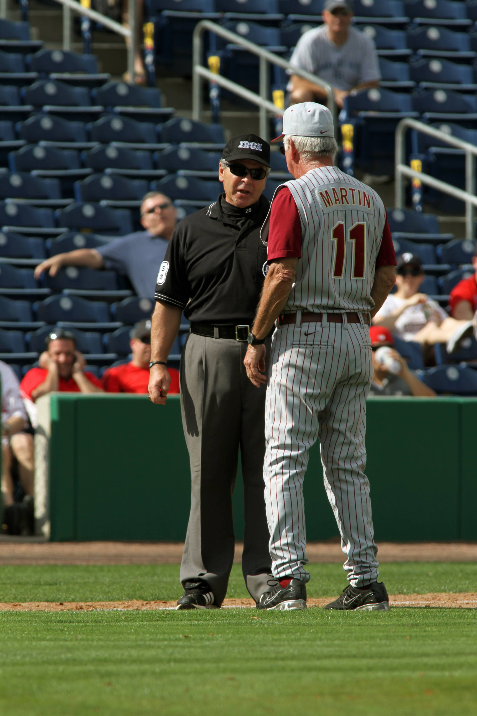 Head coach Mike Martin talks with the umpire during the game.