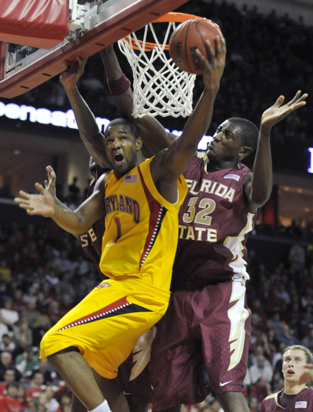 Maryland's Landon Milbourne shoots as Florida State's Solomon Alabi defends in the second half of an NCAA college basketball game, Sunday, Jan. 10, 2010, in College Park, Md. Maryland won 77-68. (AP Photo/Gail Burton)