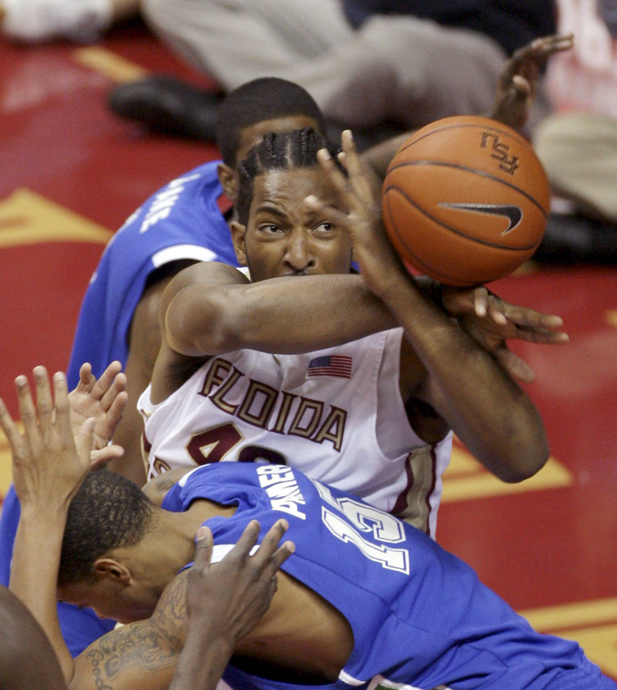 Florida State's Ryan Reid, center, battles for a first-half rebound during an NCAA college basketball game against Texas A&M-Corpus Christi, Monday, Jan. 4, 2010, in Tallahassee, Fla. (AP Photo/Phil Coale)