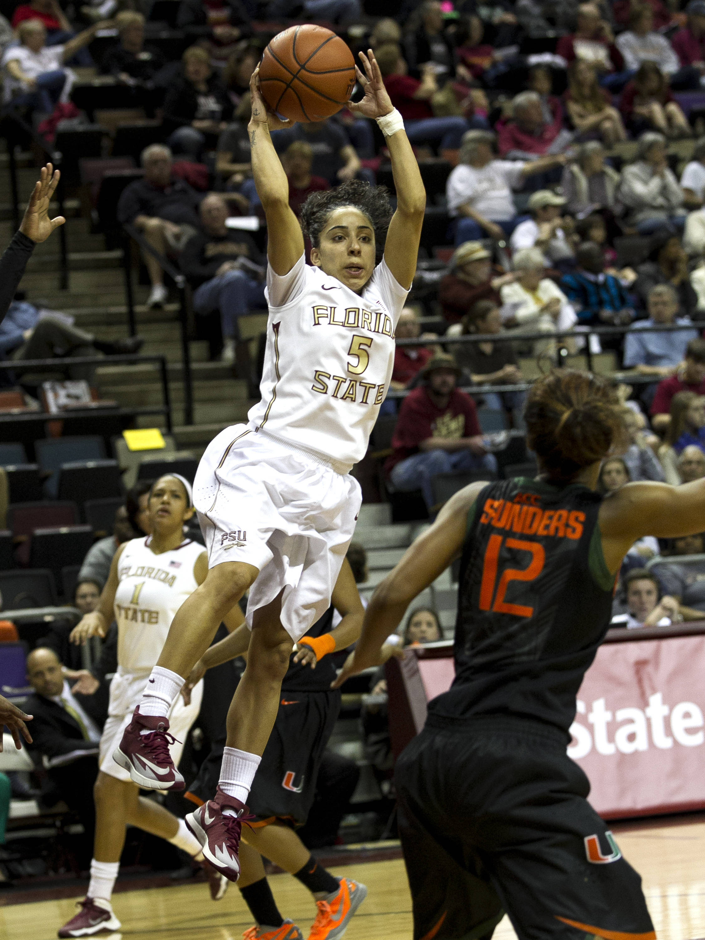 Cheetah Delgado (5) with an over the head across the lane pass, FSU vs Miami, 2-16-14, (Photo's by Steve Musco)