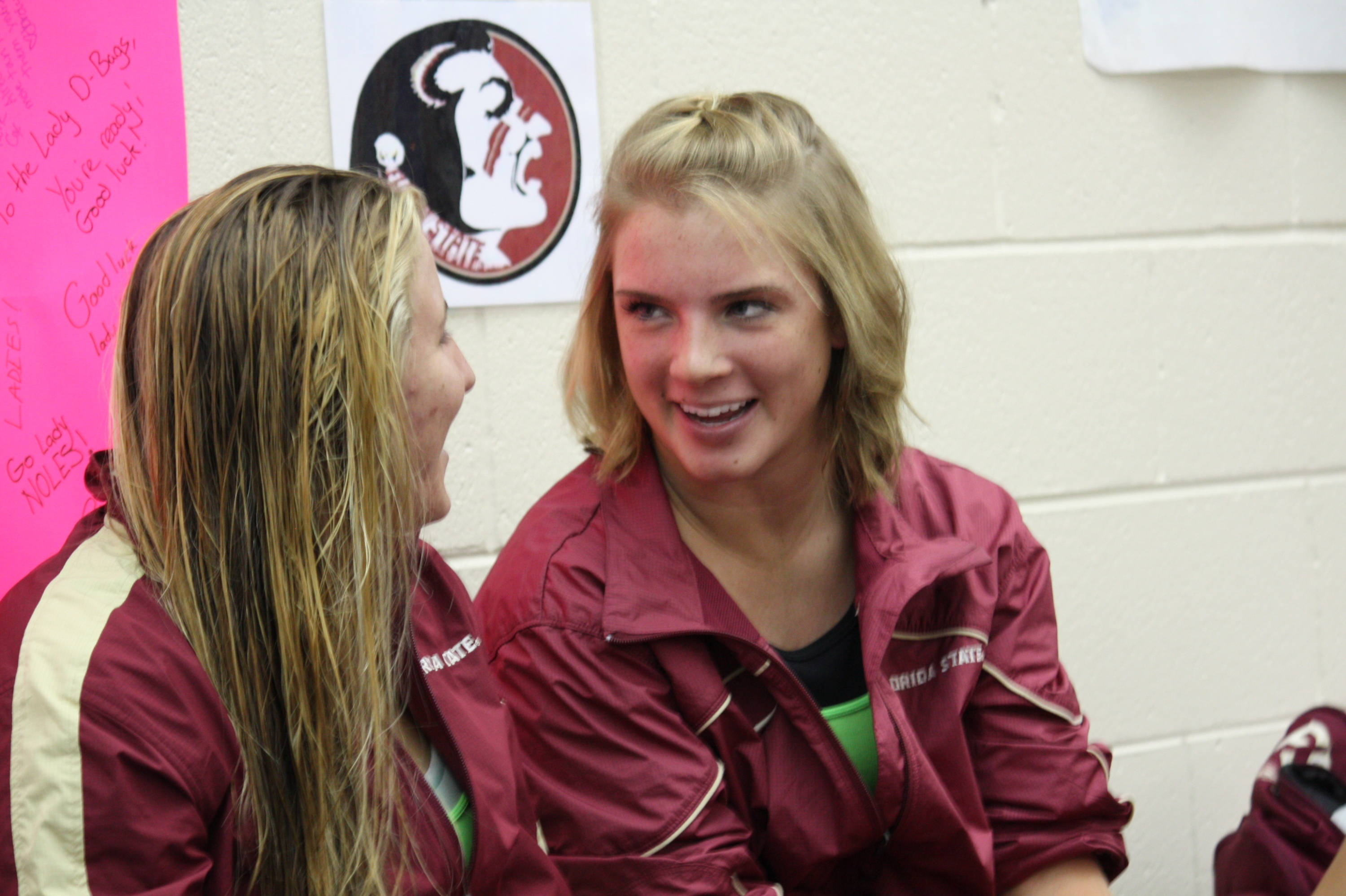 Ariel Rittenhouse and Katrina Young take a break from cheering on the swimmers to talk about their diving skills.
