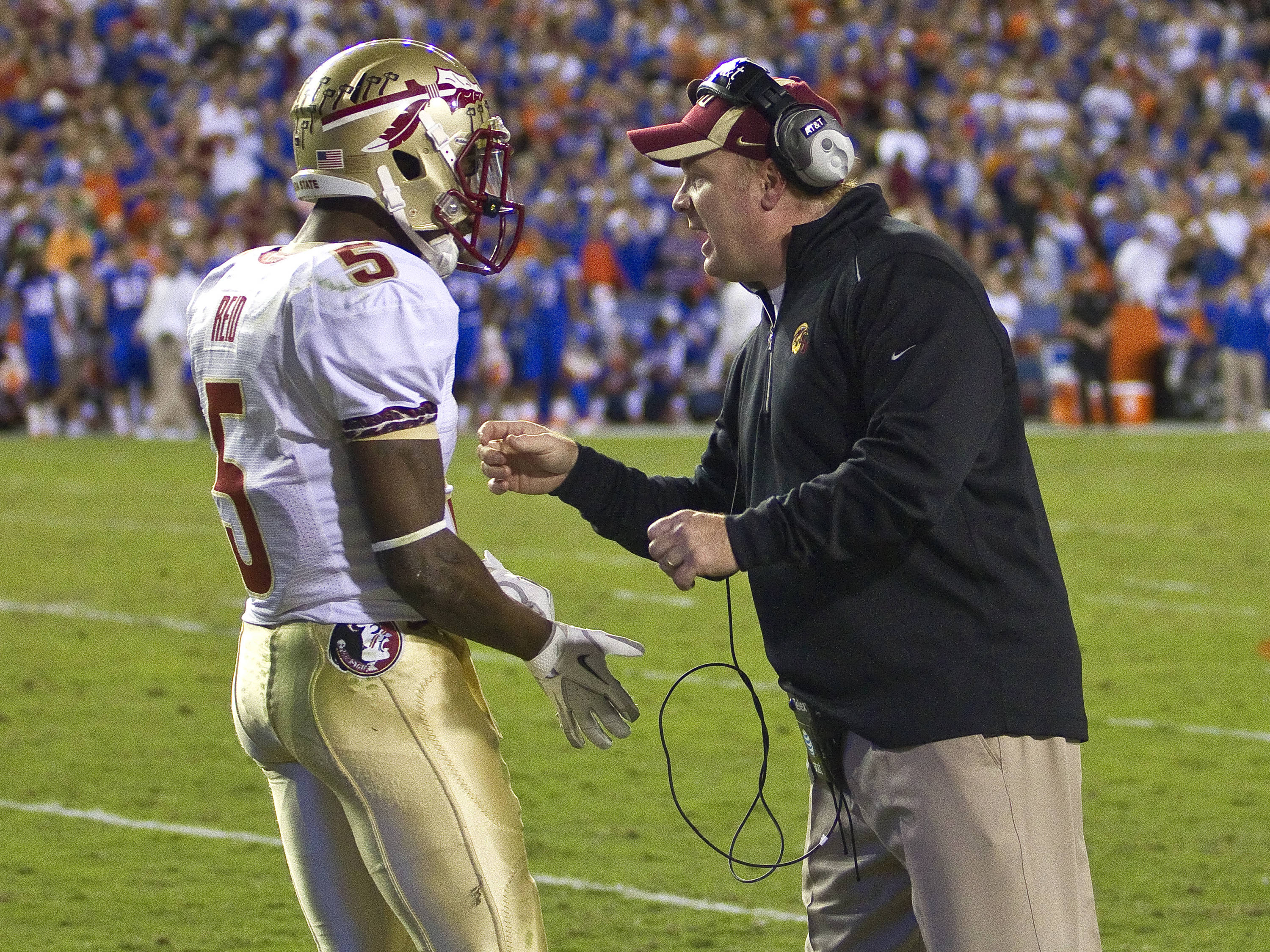 Defensive coordinator Mark Stoops with instructions to Greg Reid (5), FSU vs Florida, 11/26/2011