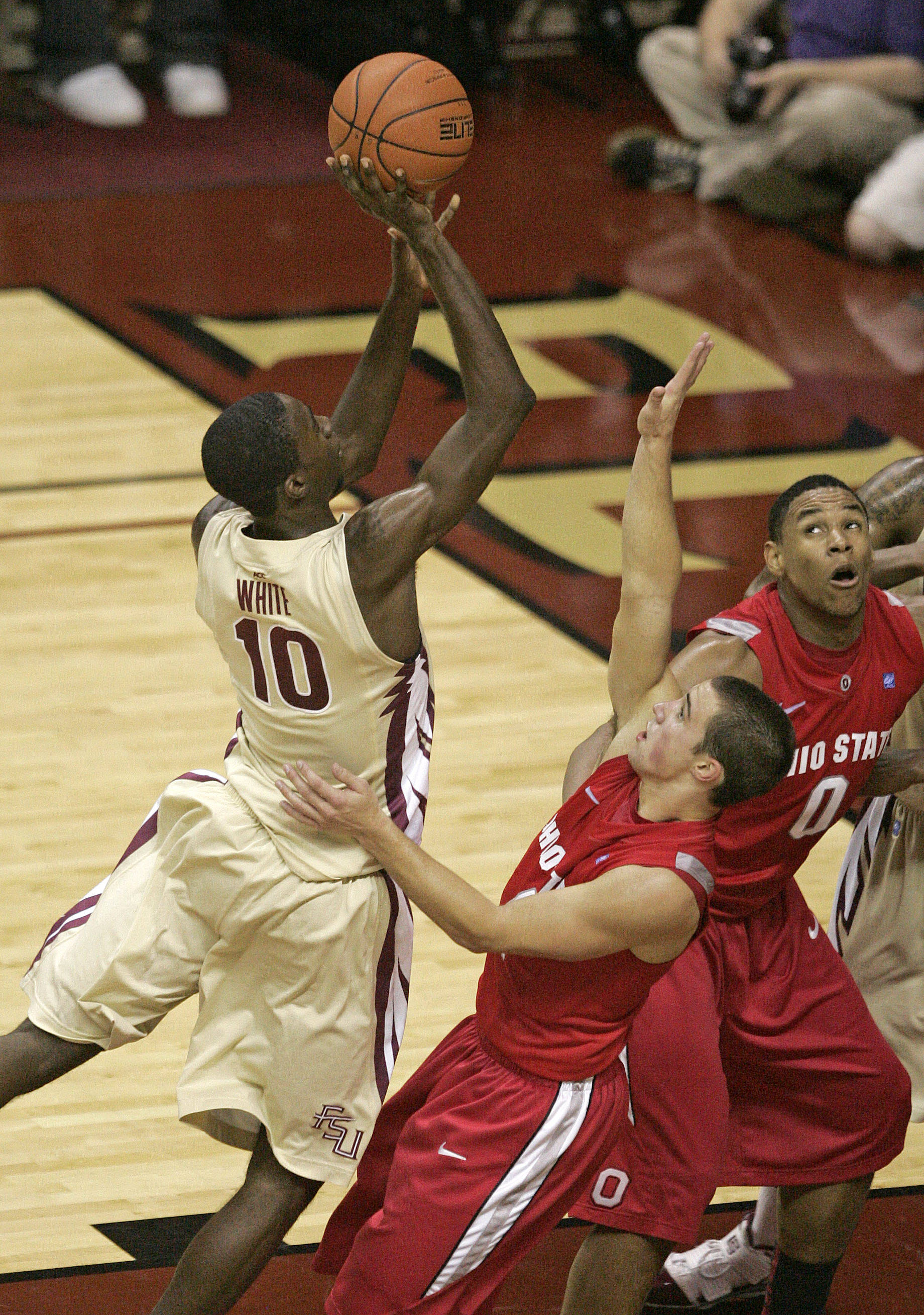Florida State's Okaro White shoots over Ohio State's Aaron Craft in the second half.(AP Photo/Steve Cannon)
