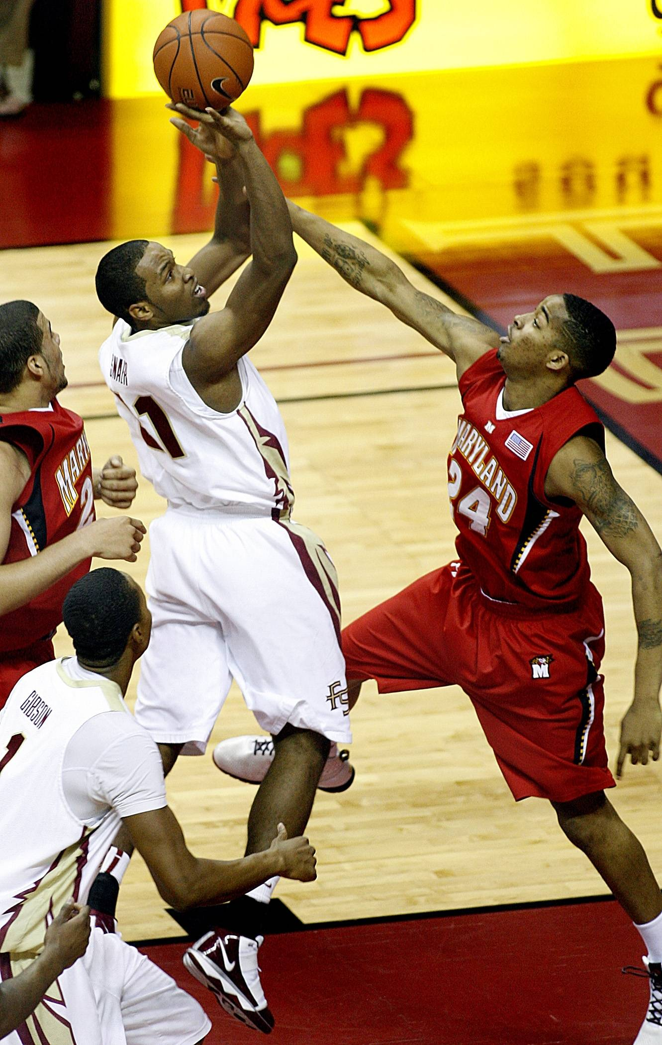 Florida State's Michael Snaer, left, shoots over Maryland's Cliff Tucker, right, during an NCAA college basketball game in Tallahassee, Fla., on Thursday, Feb. 4, 2010. (AP Photo/Tallahassee Democrat, Glenn Beil)