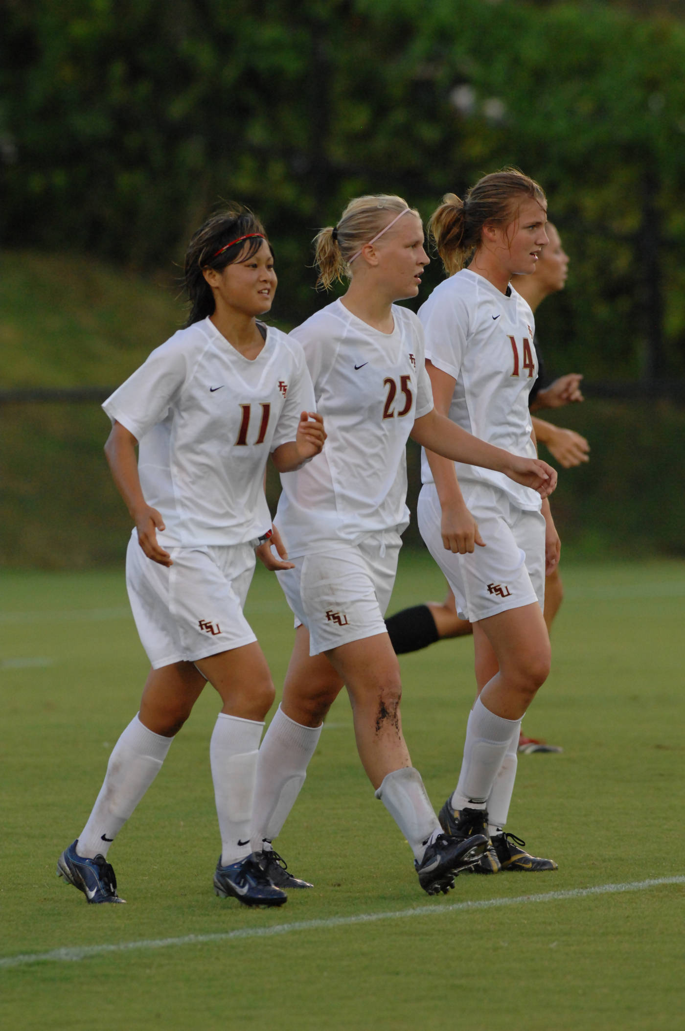 Mami Yamaguchi and Kirsten van de Ven celebrate with freshman Sanna Talonen following her second goal of the afternoon.